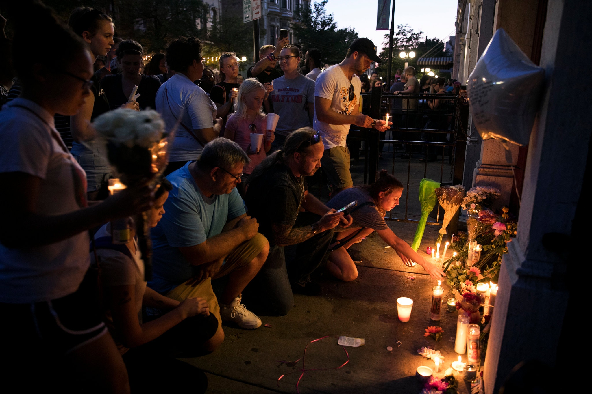 Mourners gathered at a vigil in Dayton, Ohio, on Sunday after a gunman killed nine people in the city. Credit Maddie McGarvey for The New York Times