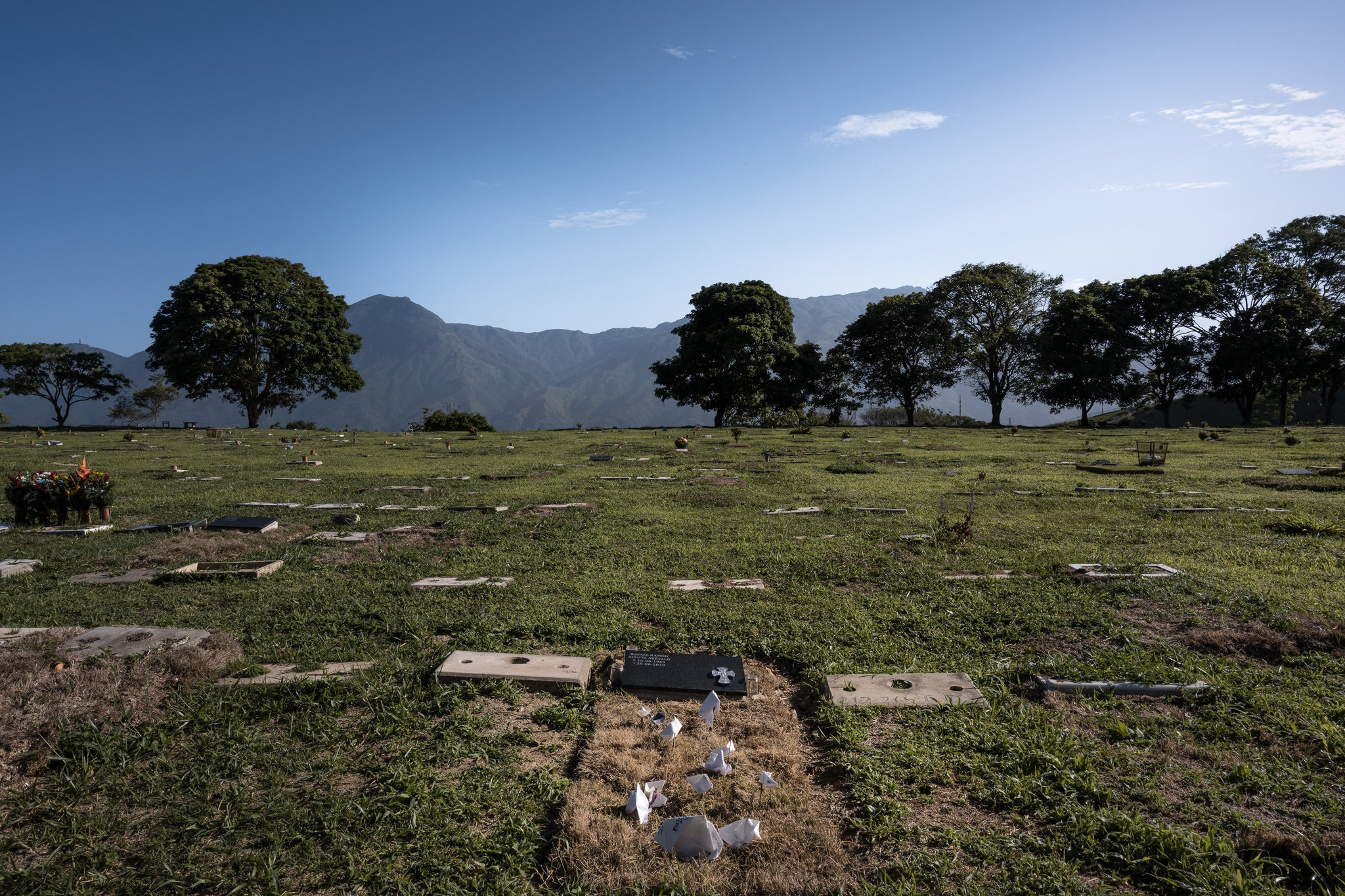The grave of Rafael Acosta, a retired navy captain who died in government custody. He was electrocuted, among other things. Credit Adriana Loureiro Fernandez for The New York Times