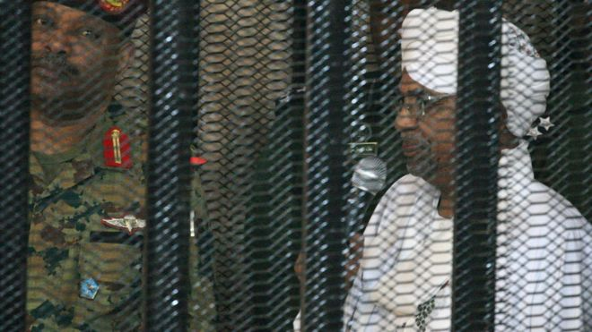 Omar al-Bashir appeared in court in a cage on Monday. Credit AFP
