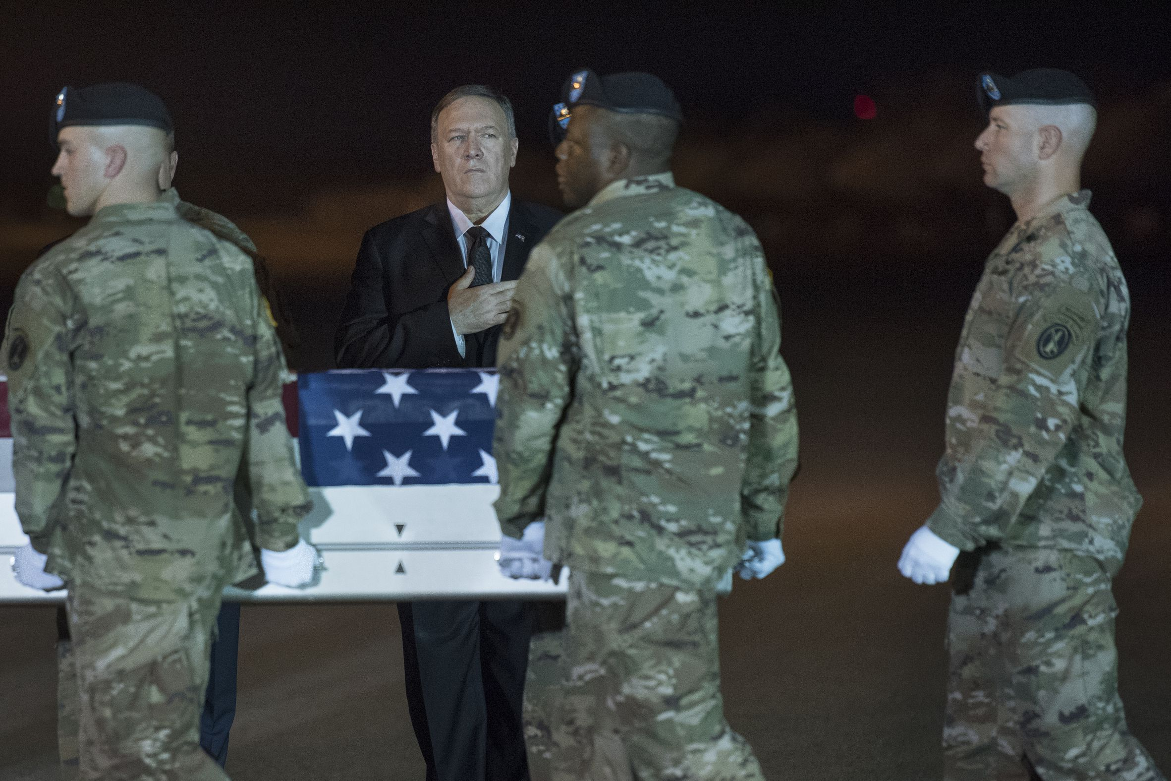 Secretary of State Mike Pompeo salutes as the remains of Sgt. 1st Class Elis Ortiz, 34, of Puerto Rico arrive Saturday at Dover Air Force Base after he was killed by a Taliban car bomb in Afghanistan. Photo: Cliff Owen/AP