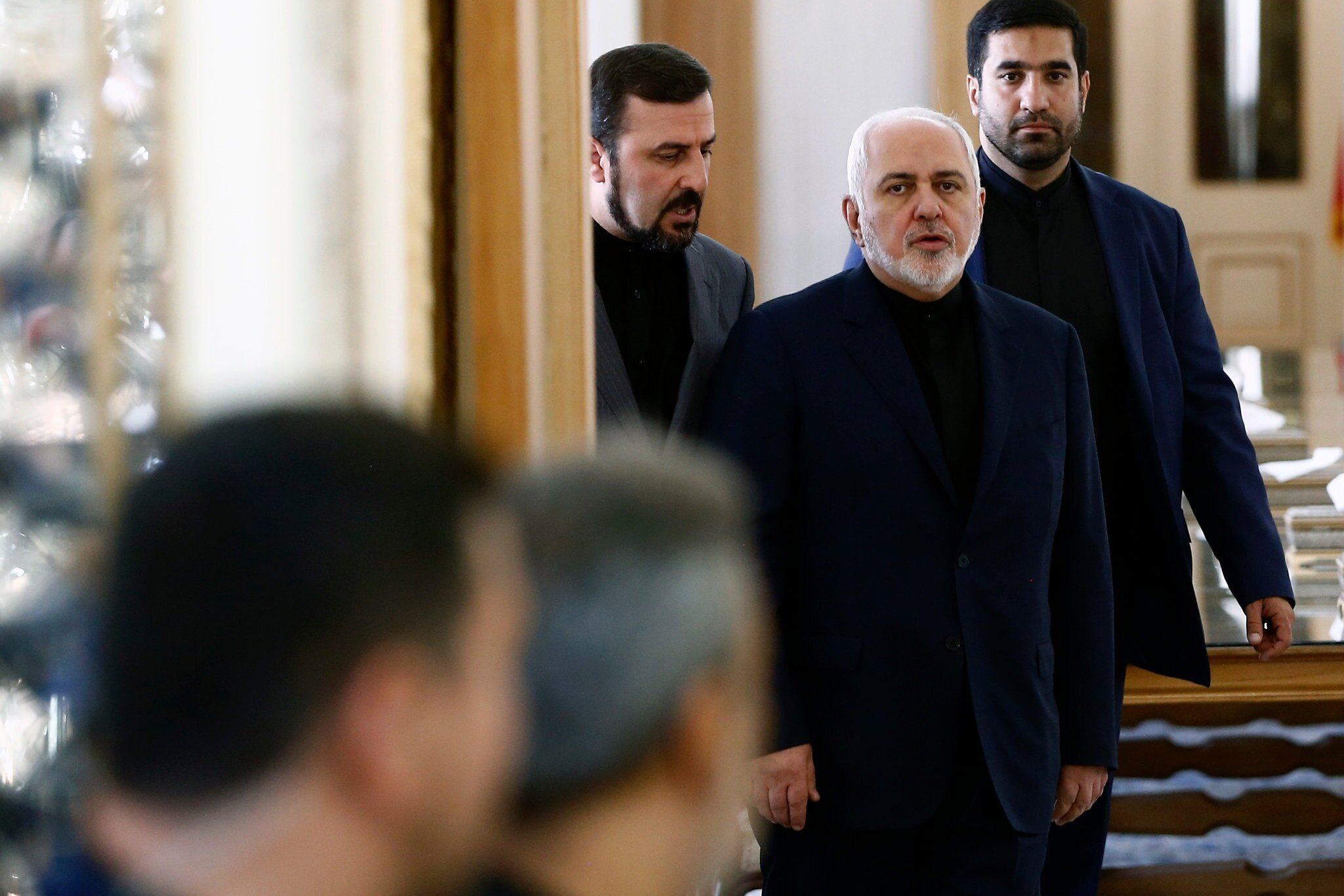 """Foreign Minister Mohammad Javad Zarif, center, told CNN that Iran """"won't blink to defend our territory."""" Credit Abedin Taherkenareh/EPA, via Shutterstock"""
