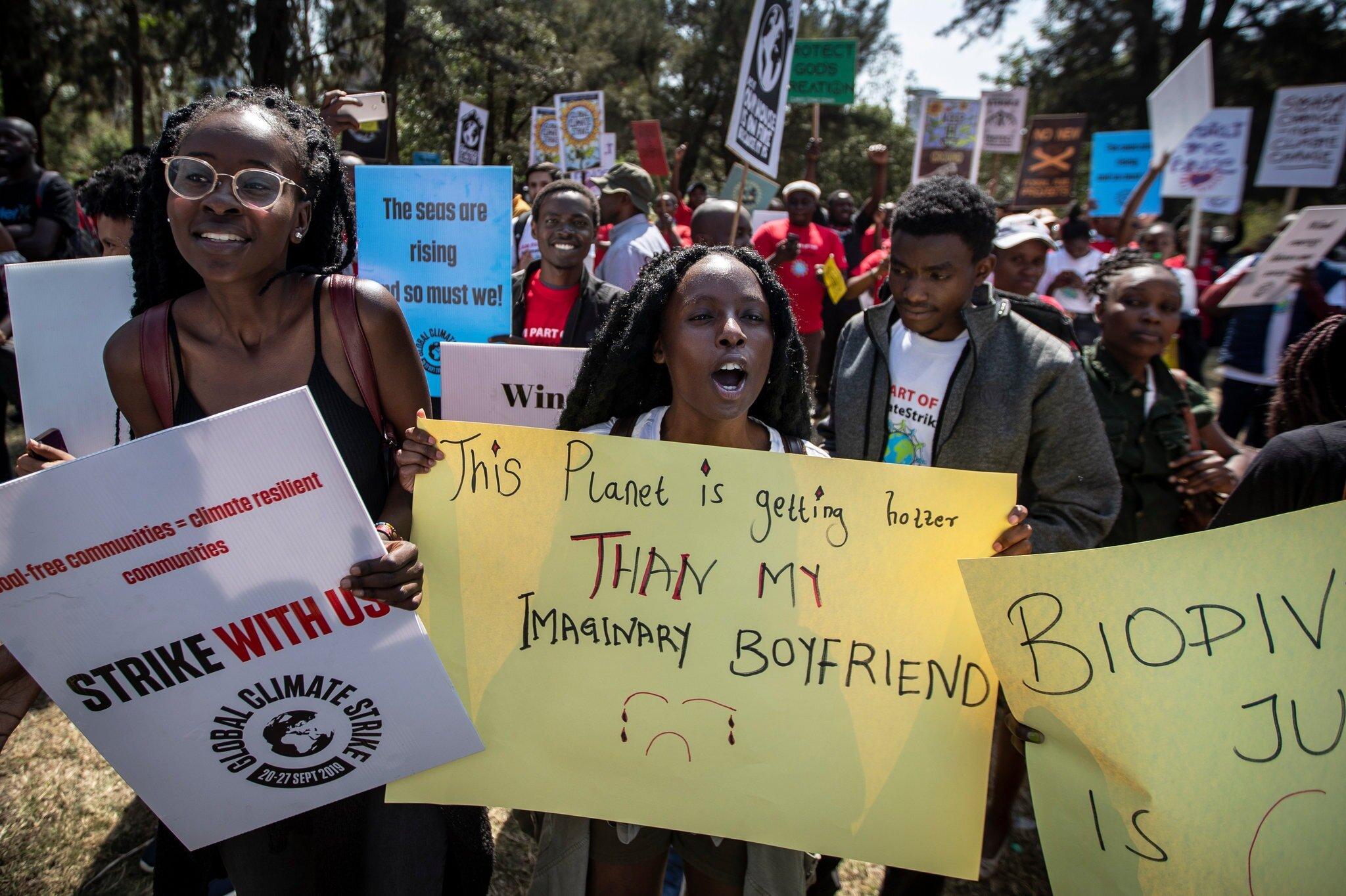 Kenyans marched through the Nairobi city center. Credit Ben Curtis/Associated Press