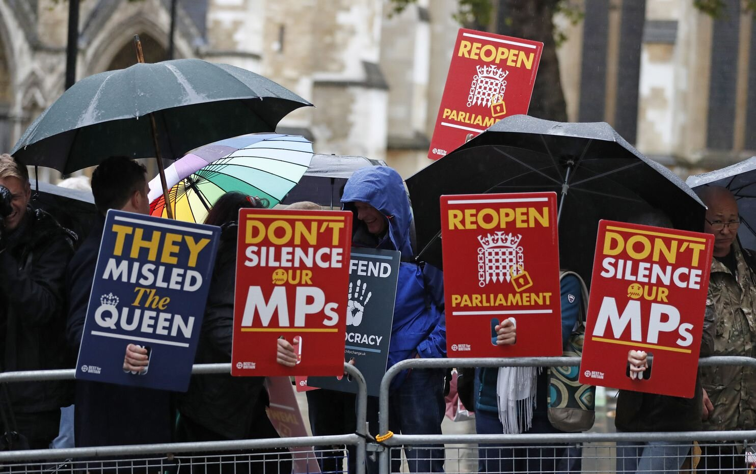 Anti-Brexit supporters gather in the rain outside the Supreme Court in London, Sept. 24, 2019. (Frank Augstein/AP)