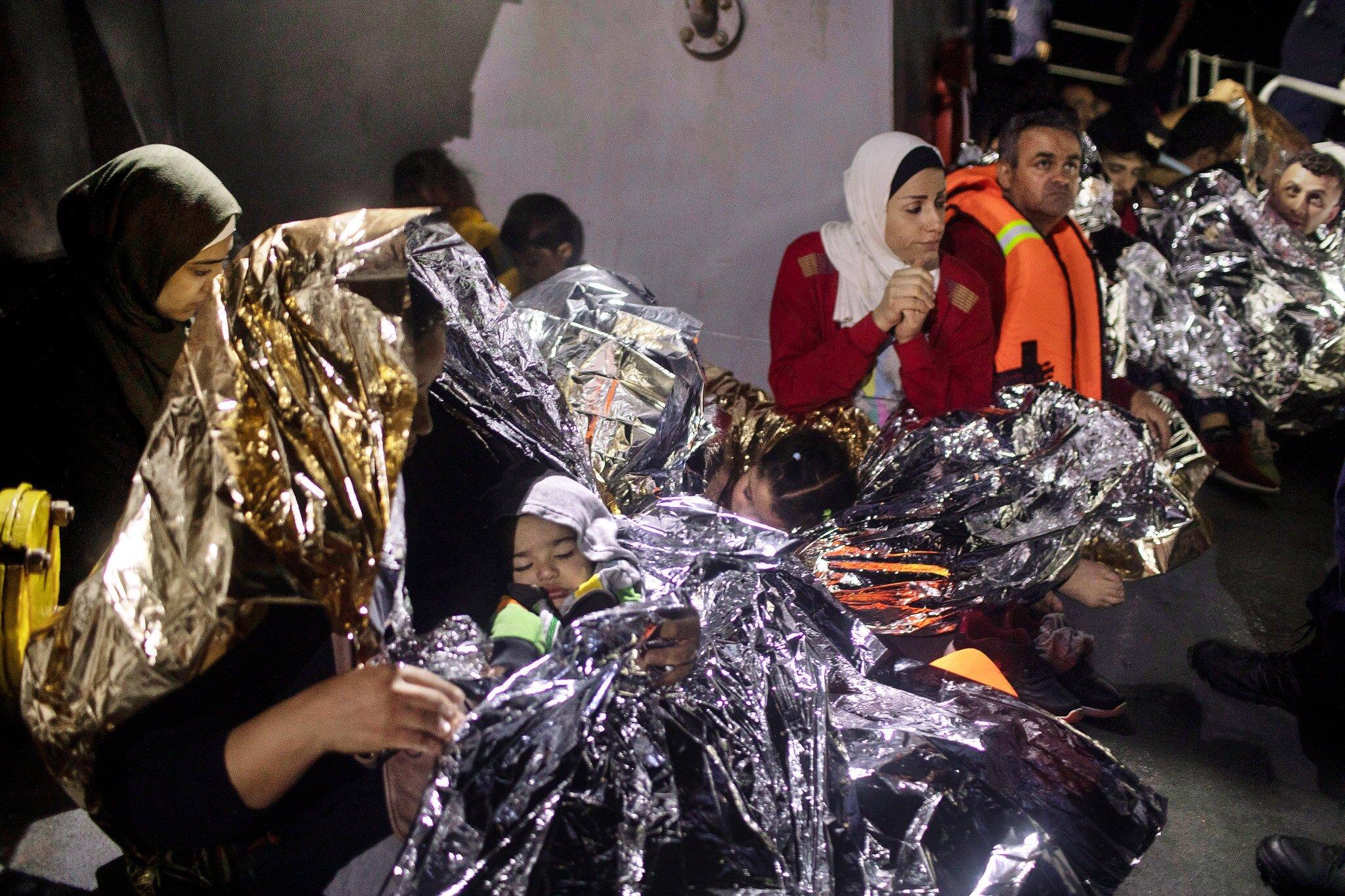 Refugees were rescued Thursday by a Greek Coast Guard ship near the island of Samos. Credit Petros Giannakouris/Associated Press