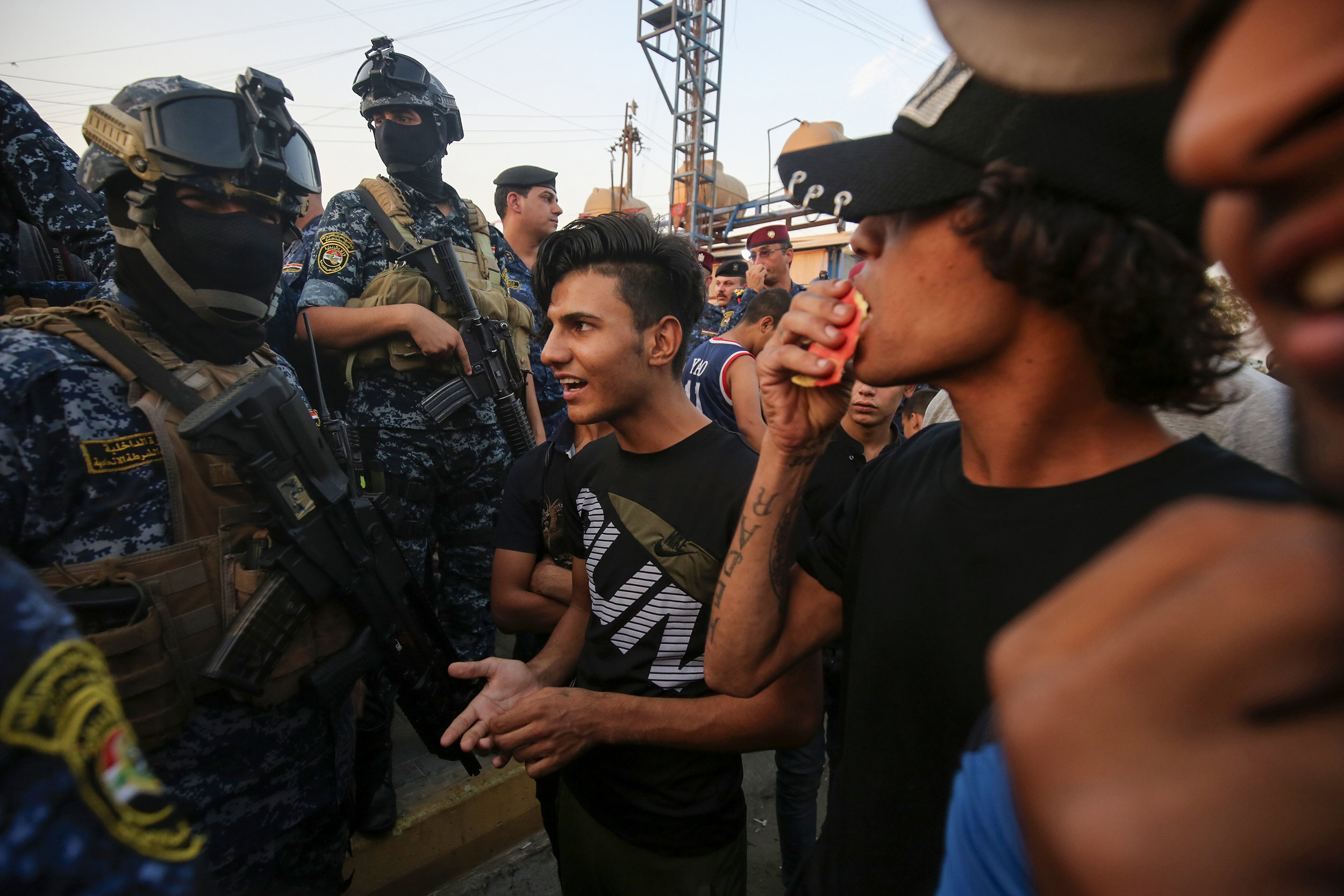 Iraqi protesters speak with police in Baghdad's predominantly Shiite district of Sadr City on Oct. 7. Ahmad Al-Rubaye/AFP/Getty Images