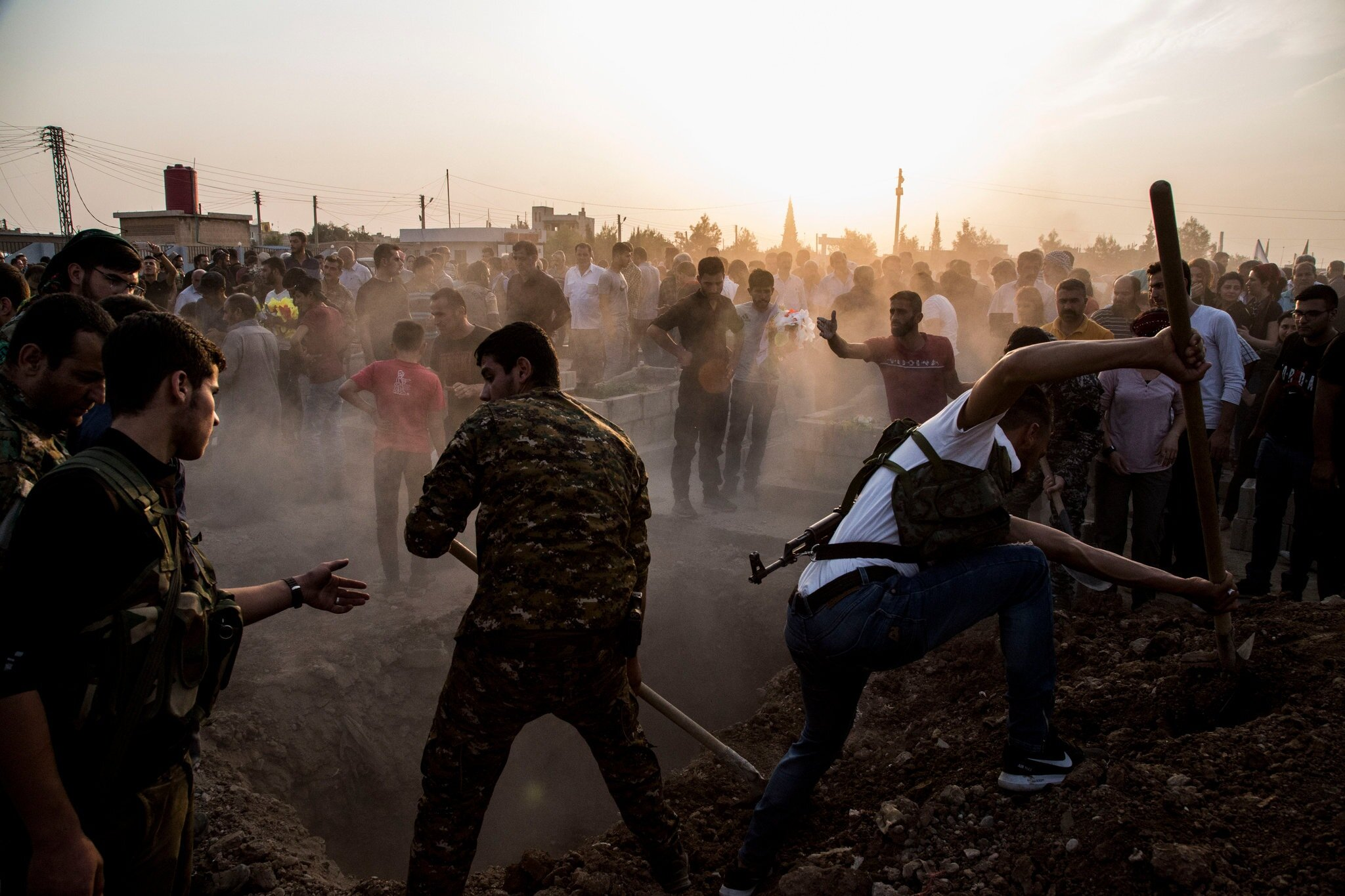 Syrian Democratic Forces fighters killed during the Turkish advance were buried in Qamishli, Syria, on Saturday. Credit Baderkhan Ahmad/Associated Press