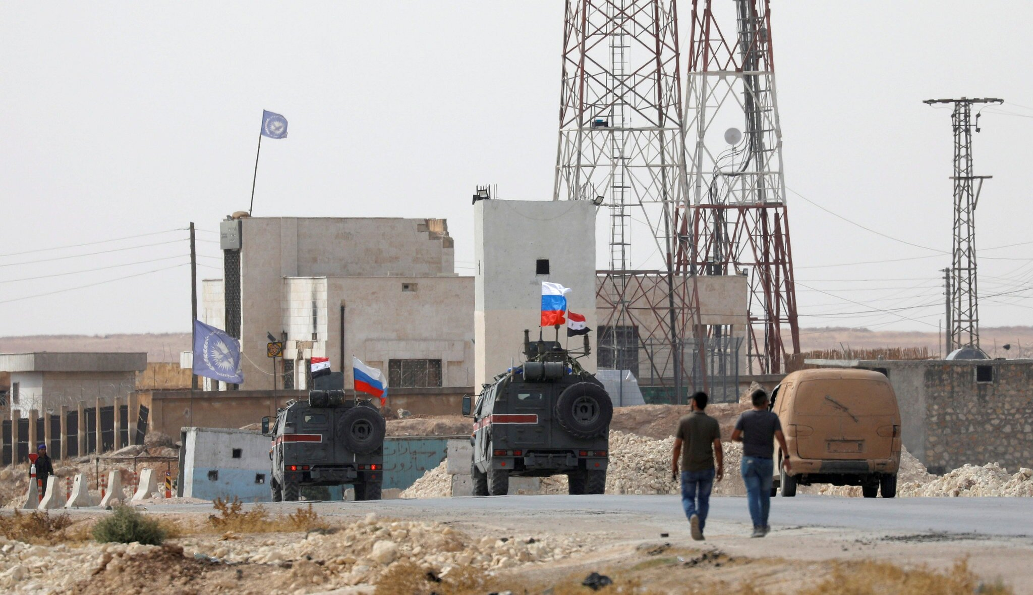 Russian and Syrian flags on military vehicles near Manbij, Syria, on Tuesday. Credit Omar Sanadiki/Reuters