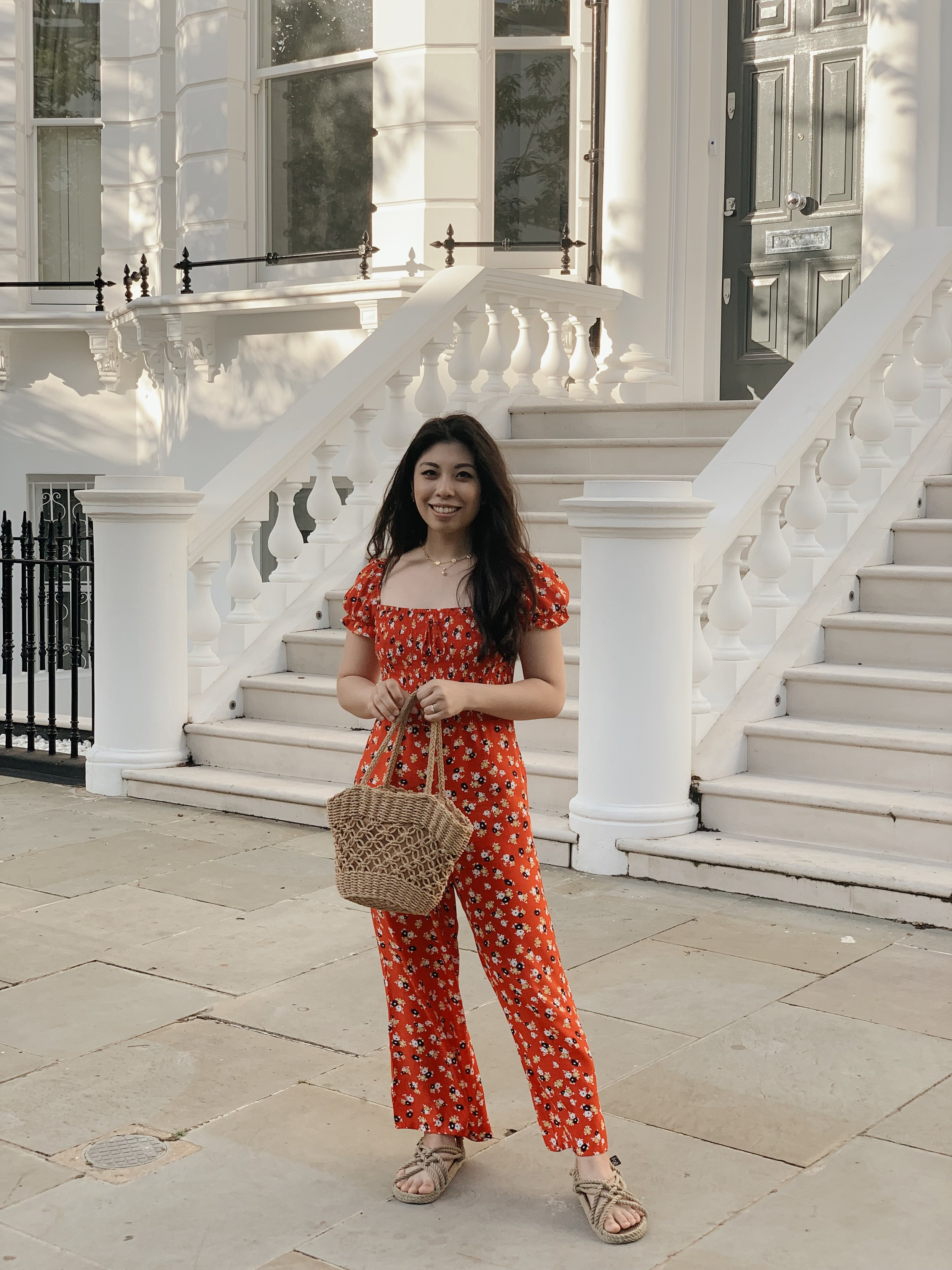 I'm wearing  this red floral jumpsuit .