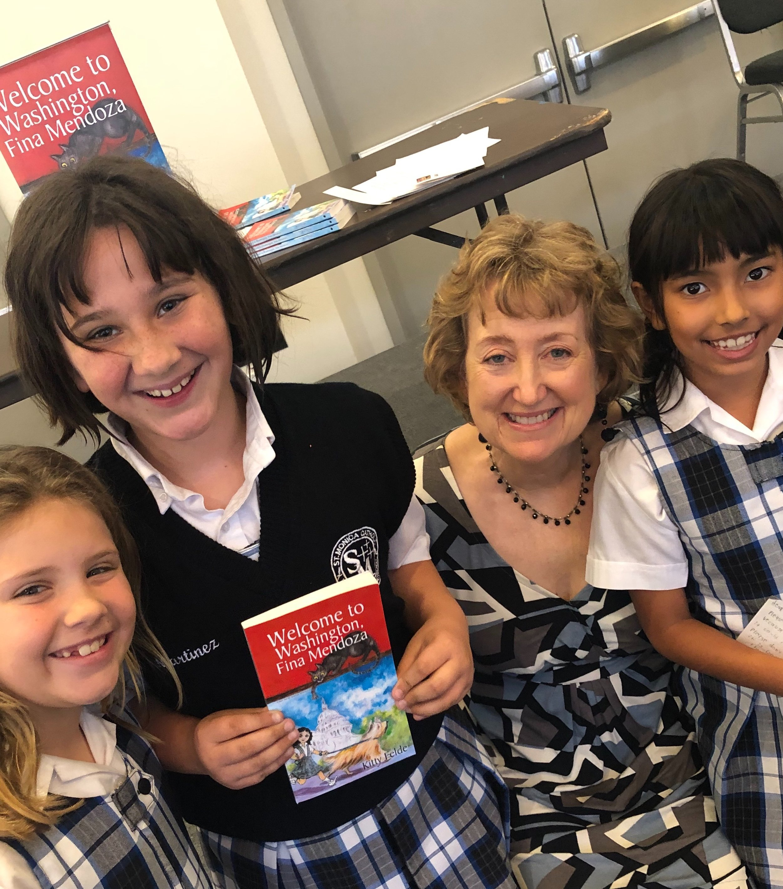 Kitty talks about writing, Congress, and the legend of the Demon Cat with students at St. Monica Elementary School in California.
