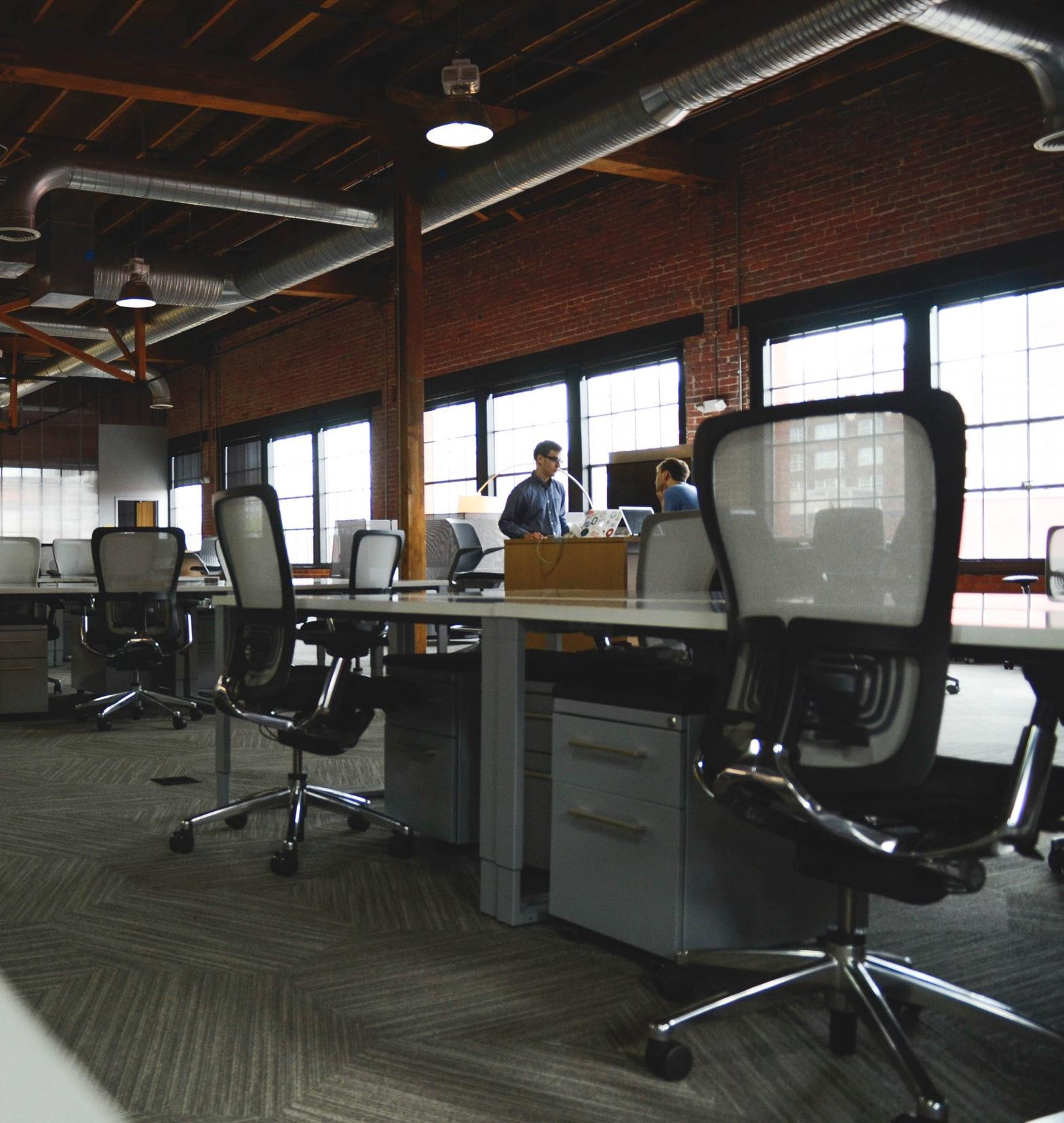 Canva+-+Two+Men+Having+Conversation+Next+to+Desk+in+Building.jpg