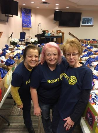 Turkey baskets - Satellite Club members Carmelina Trifiletti and Amy Leadbetter joined with Neva Lynde and other club members to prepare turkey baskets for Grove Christian Outreach Center clients.