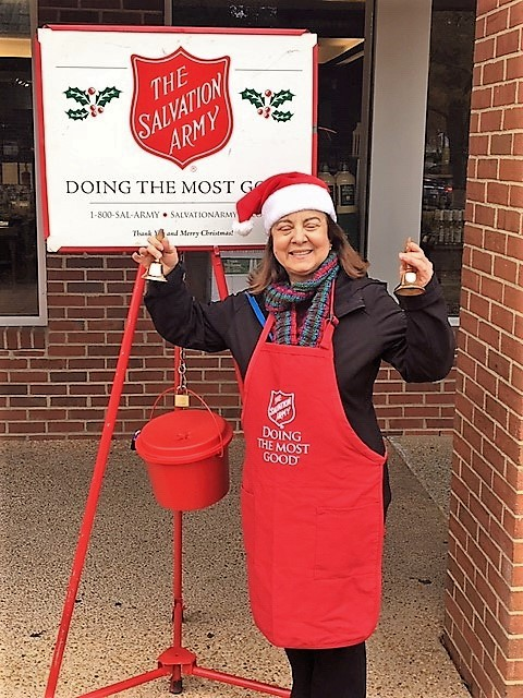 "SALVATION ARMY BELL RINGING - Our clubs rang the bells at two Williamsburg locations during two weekends in December. Here we show Satellite Club member Carmelina Trifelleti ""ringing in"" the green."