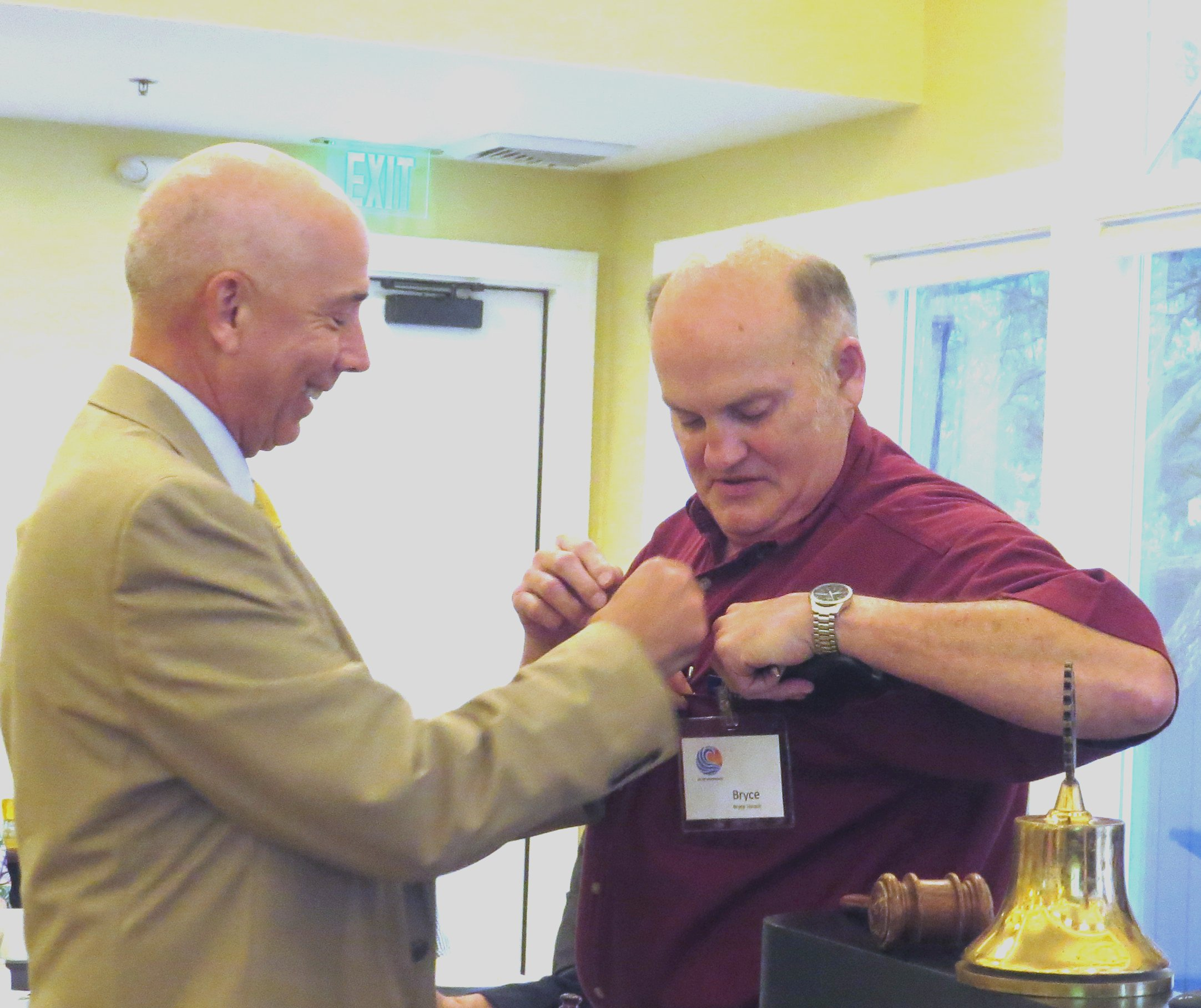 new member - Bryce received his Rotary pin from President Bill