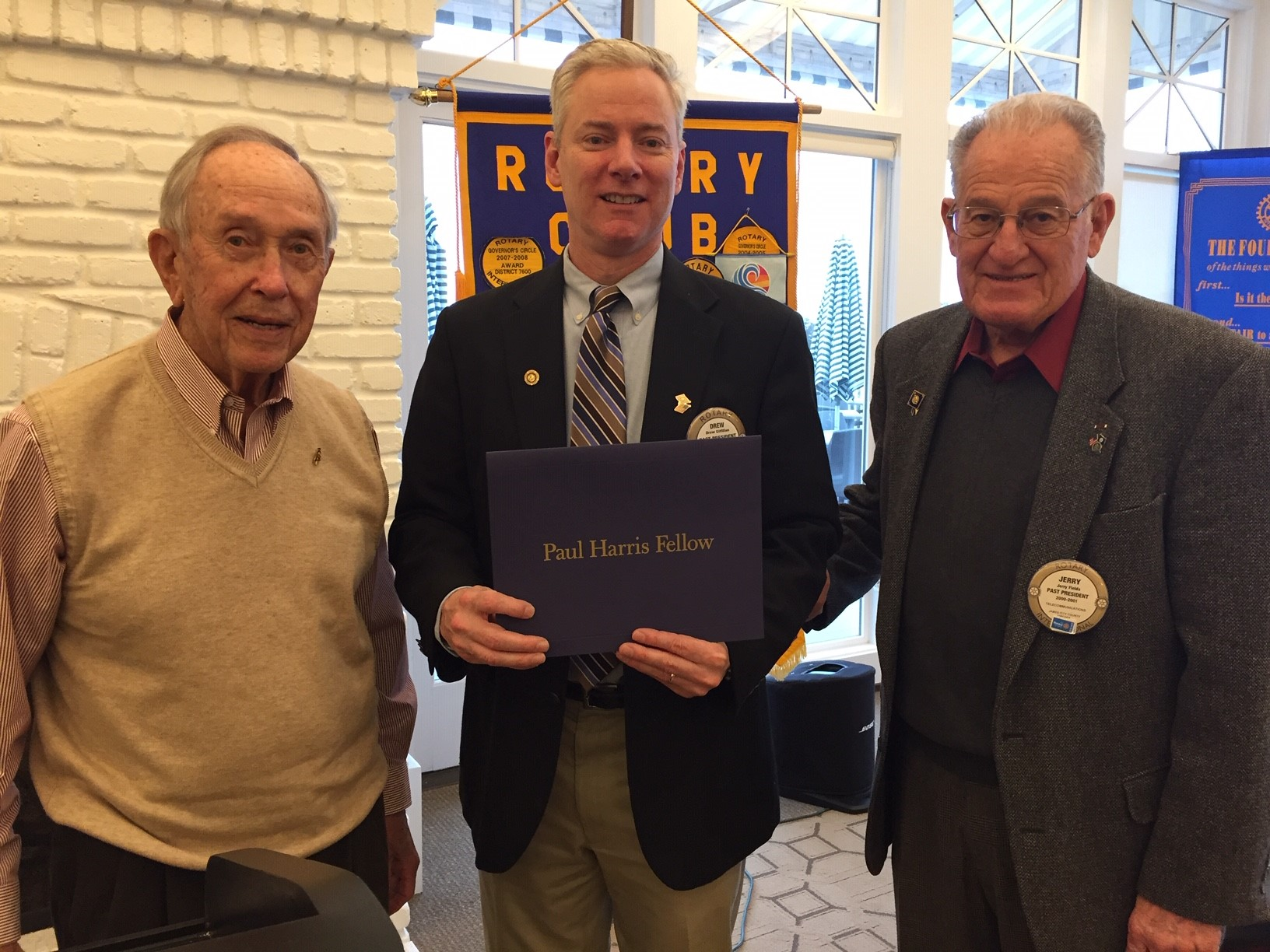 new paul harris fellow - Hal Campbell (left) and Jerry Fields (right) congratulate our newest Paul Harris member, Dr. Drew Gilfillan (center).