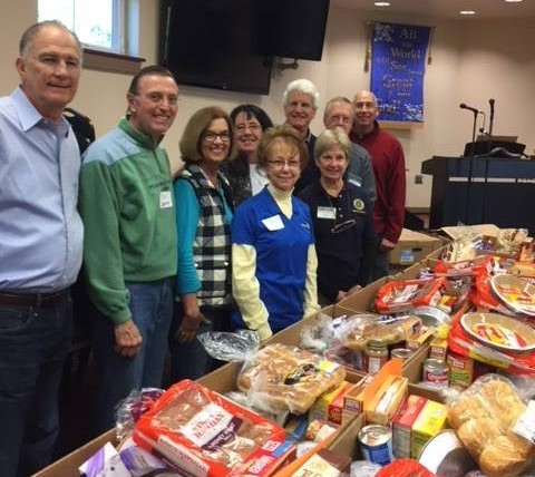 Thanksgiving preparations - Club members help at Grove Christian Outreach for Thanksgiving preparations.