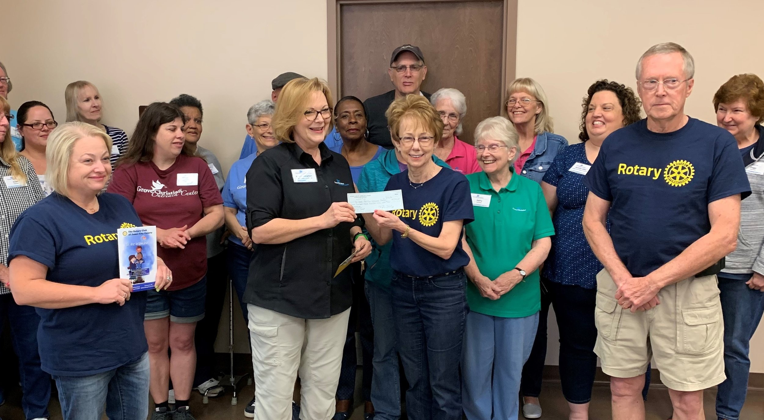 JCC Rotarians Present Grant to Grove Christian Outreach. JCC Rotary and Satellite Club members Amy Leadbetter, Neva Lynde and Roger Saunders presented a $7,350 check to Ruth Cunningham, Grove Christian Outreach, to fund 200 food baskets for their holiday food basket program.