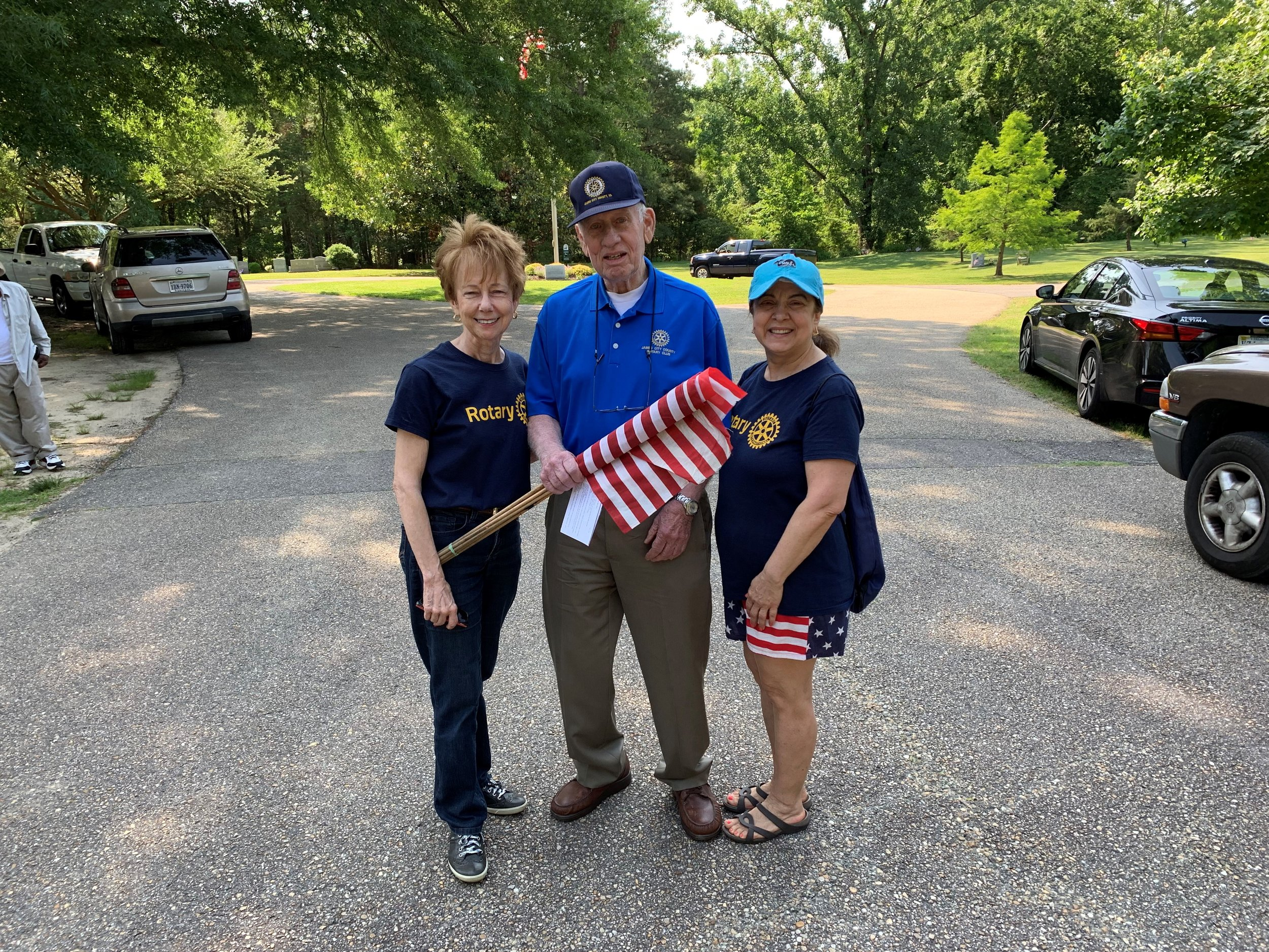 memorial day preps - Neva, John and Carmelina help with placement of flags on veterans graves in Cedar Grove Cemetery