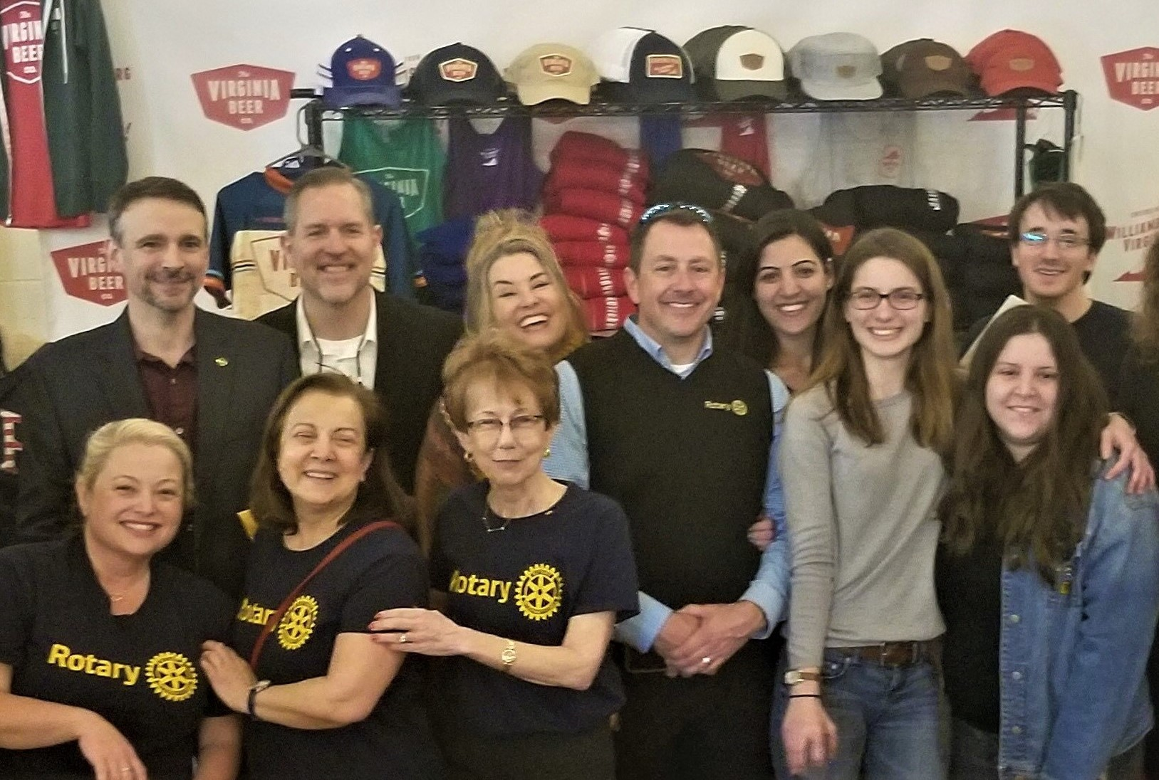 Satellite Club Members volunteer at a Rotaractor fundraiser at the Virginia Beer Company to help raise funds for a wheelchair-accessible van for a local family.