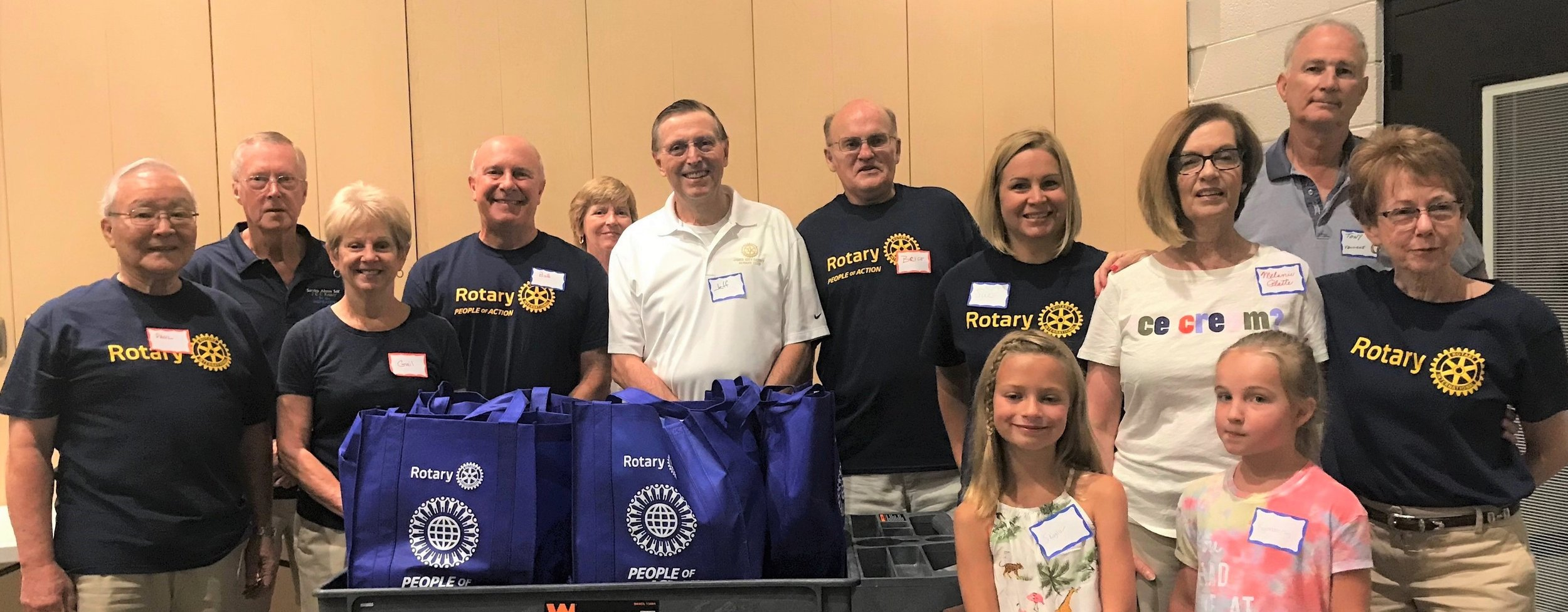 Many Rotarians helped at the Williamsburg House of Mercy food drive in August 2019.