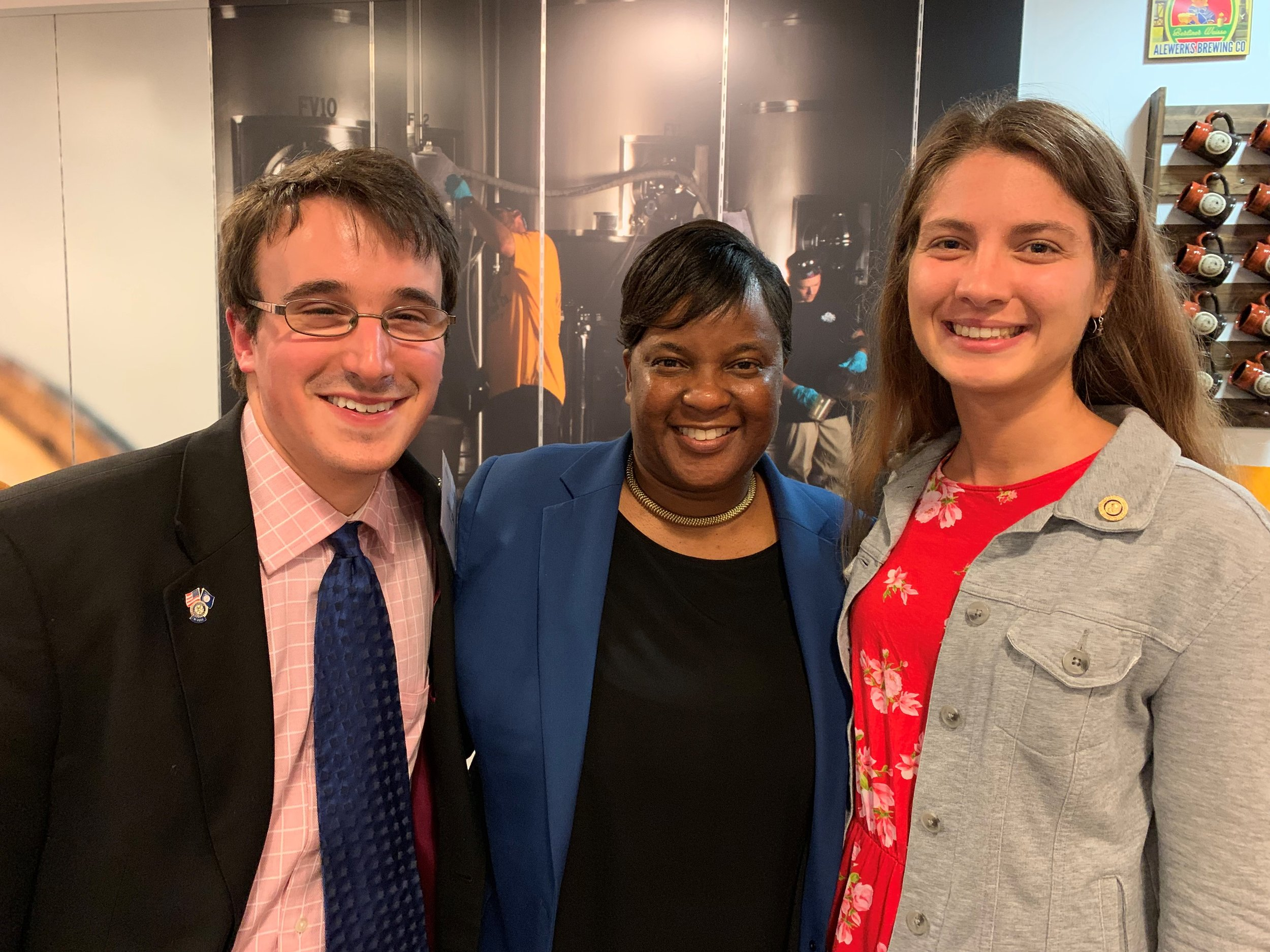 New paul harris fellow - Seyda Celci, right, President of Williamsburg Rotaract Club, awarded PHF by the Satellite Club. DG Clenise Plattt, center, and member Grayson Moore, left, join in the celebration.