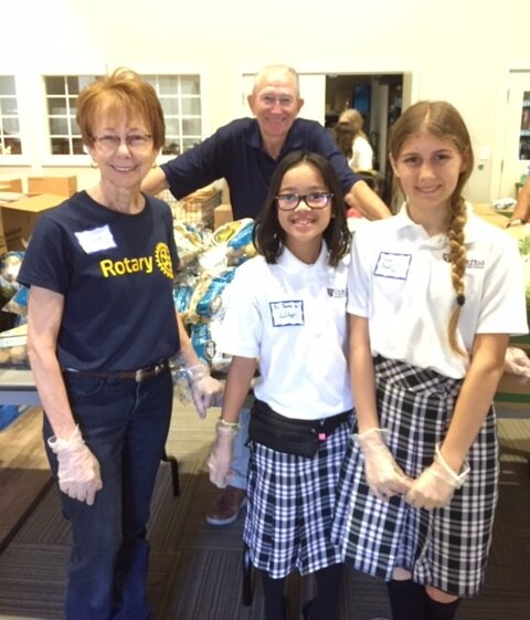 community support - JCC Rotarians Neva and Ron Lynde, along with students from Veritas Preparatory School volunteer every month at the WHOM mobile food pantry.