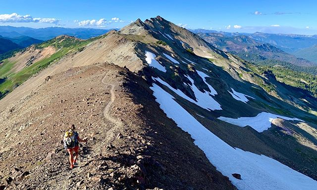 "In reflection of Goat Rocks Wilderness. • August 1, 2019 • ""By the time I was leaving camp for the highly anticipated Goat Rocks, I felt just about back to normal. And when I pushed over the first pass- sweating and smiling, feeling the muscles pulse in my legs- I felt on top of the world. I don't think you ever feel as grateful for your strength until it's been taken away from you. On the other side of the pass, the land opened up into a gorgeous valley where the trail wrapped around its edges like a loving hug, fully embracing a gushing ravine amidst purple and white wildflowers."" Read full post by heading to lupinehikes.com under the 'journal' tab. While you're there, subscribe to the mailing list! • • • #pct #pct2019 #pctclassof2019 #goatrocks #goatrockswilderness #knifesedge #womenwhohike #hikelikeagirl #withguthook #hmgtribe #thruhike #thruhike2019 #mtadams"