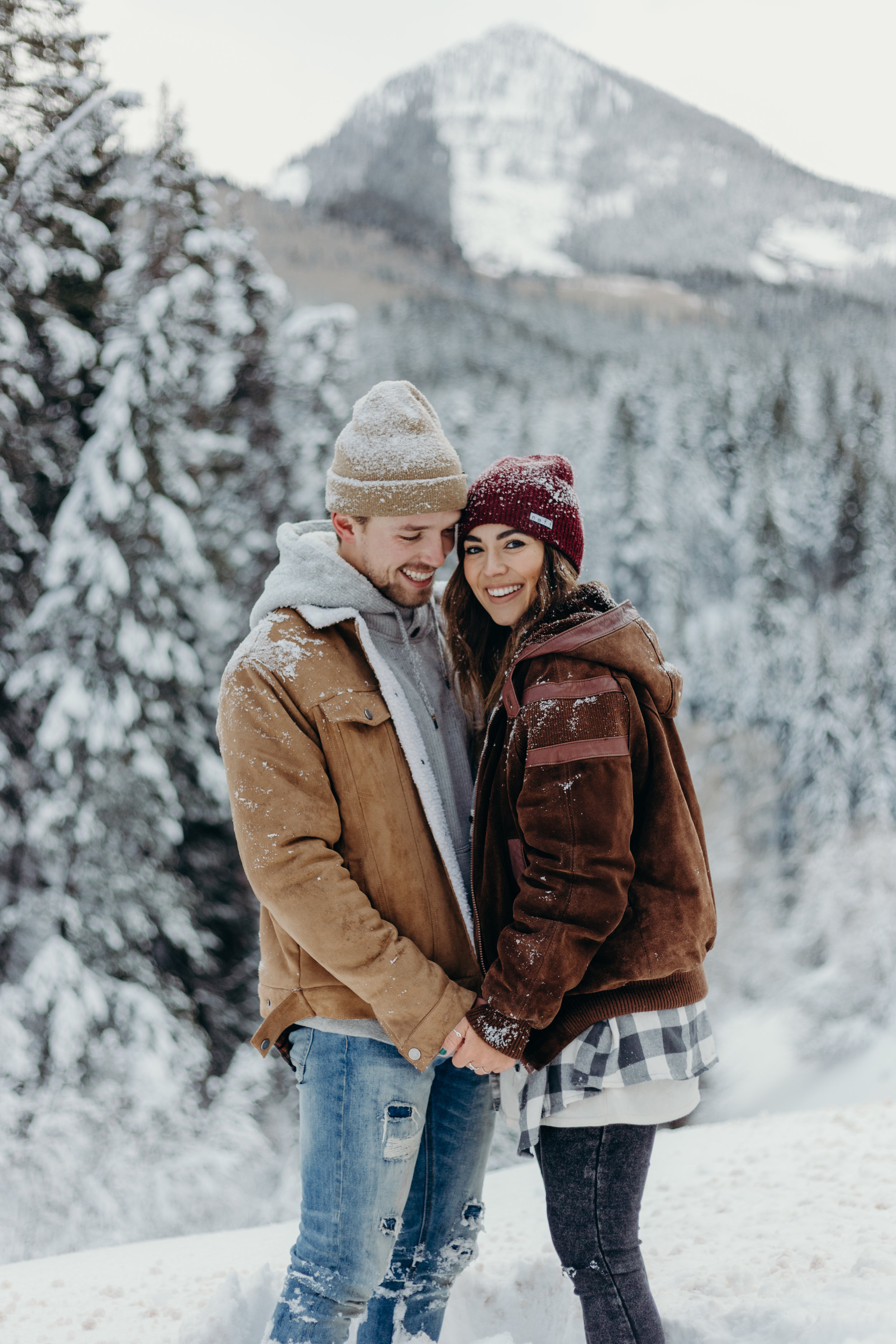 Winter engagement session in the mountains pine trees