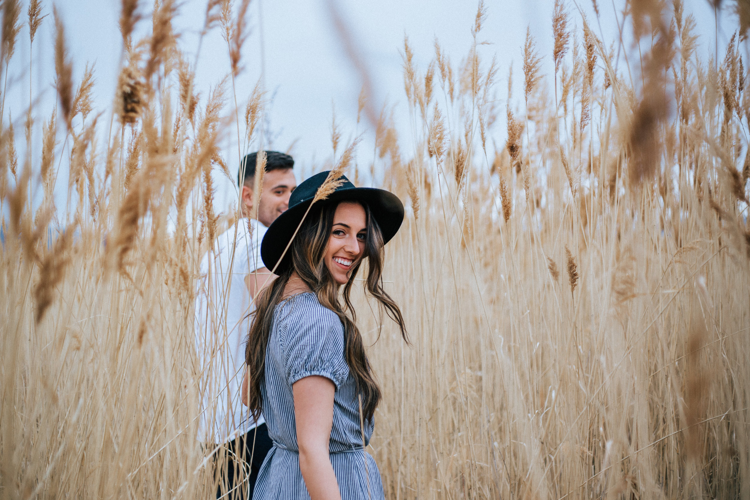 Summer night engagements in tall grass Utah photographer