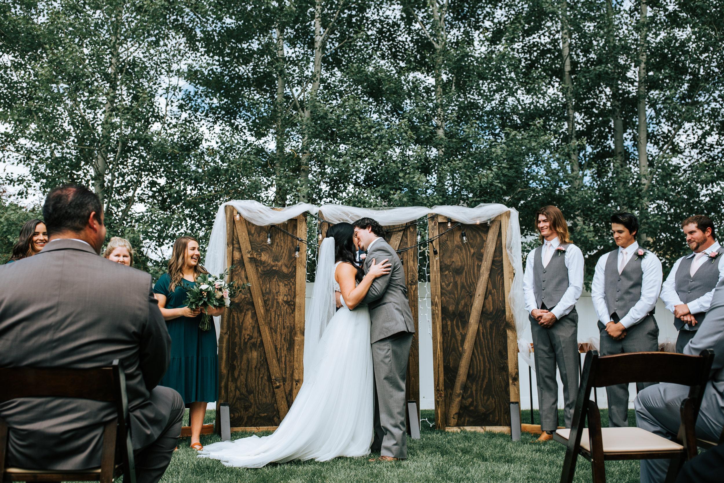 Utah backyard wedding trees wood backdrop