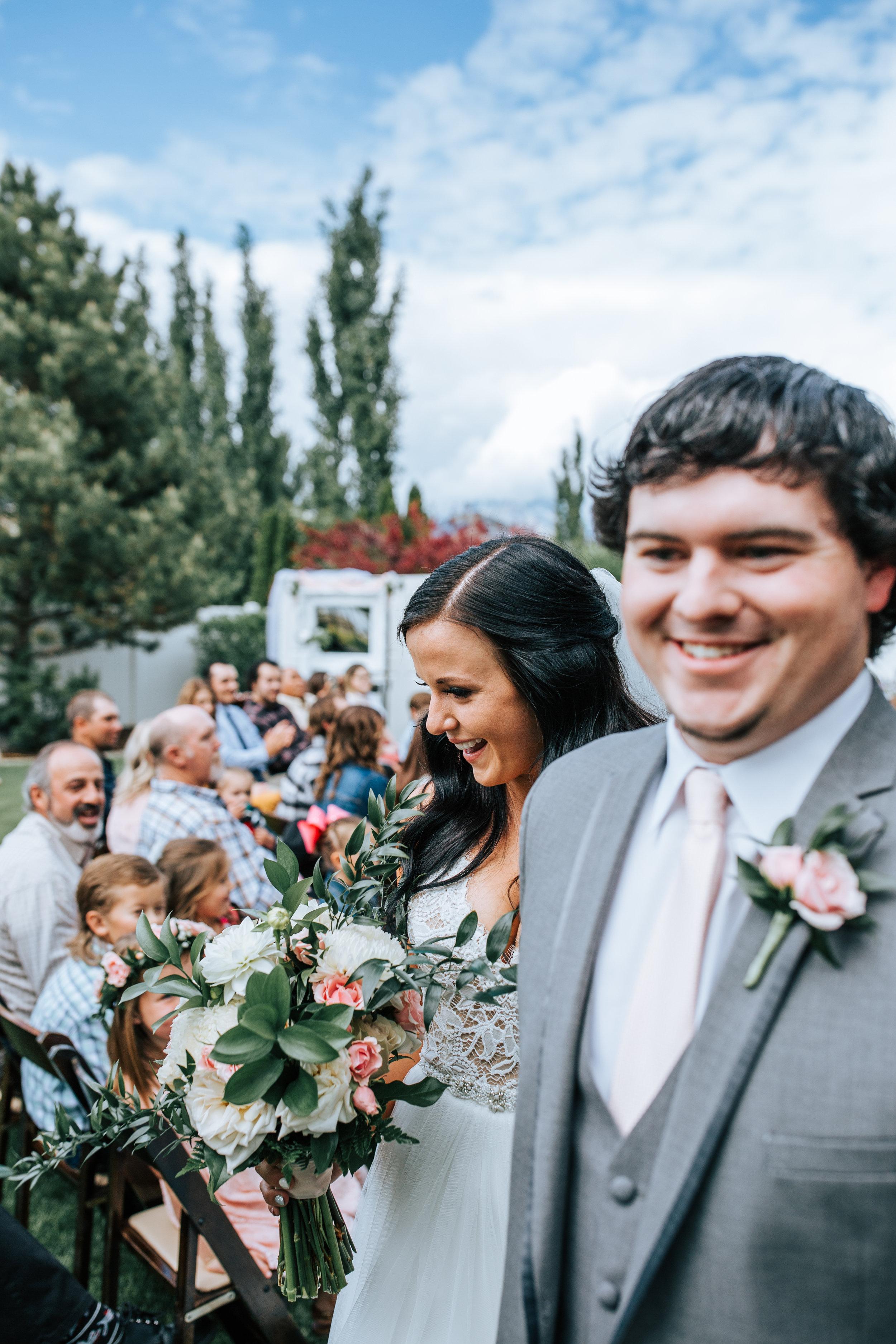 Utah backyard wedding ceremony bride and groom exit