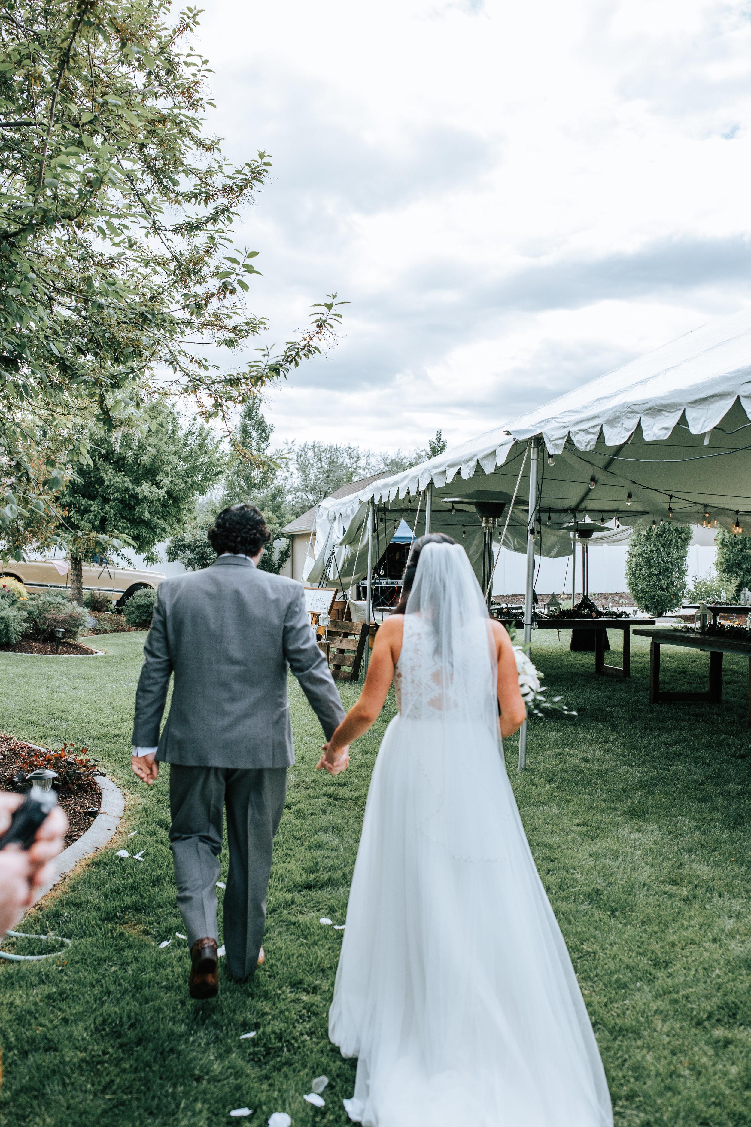 Utah bride and groom exit backyard wedding