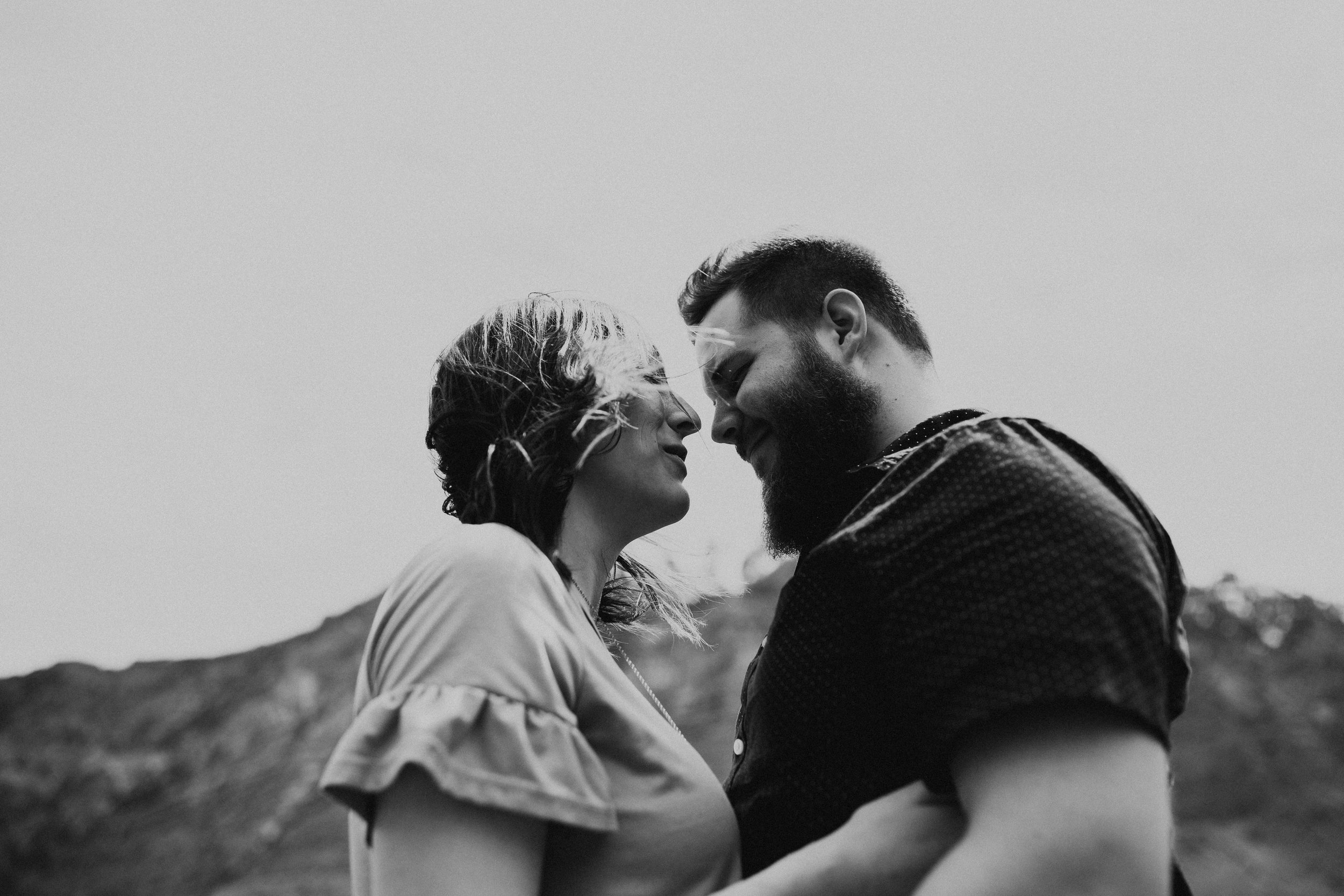 Windy mountain couples photos in Utah windflower field black and white