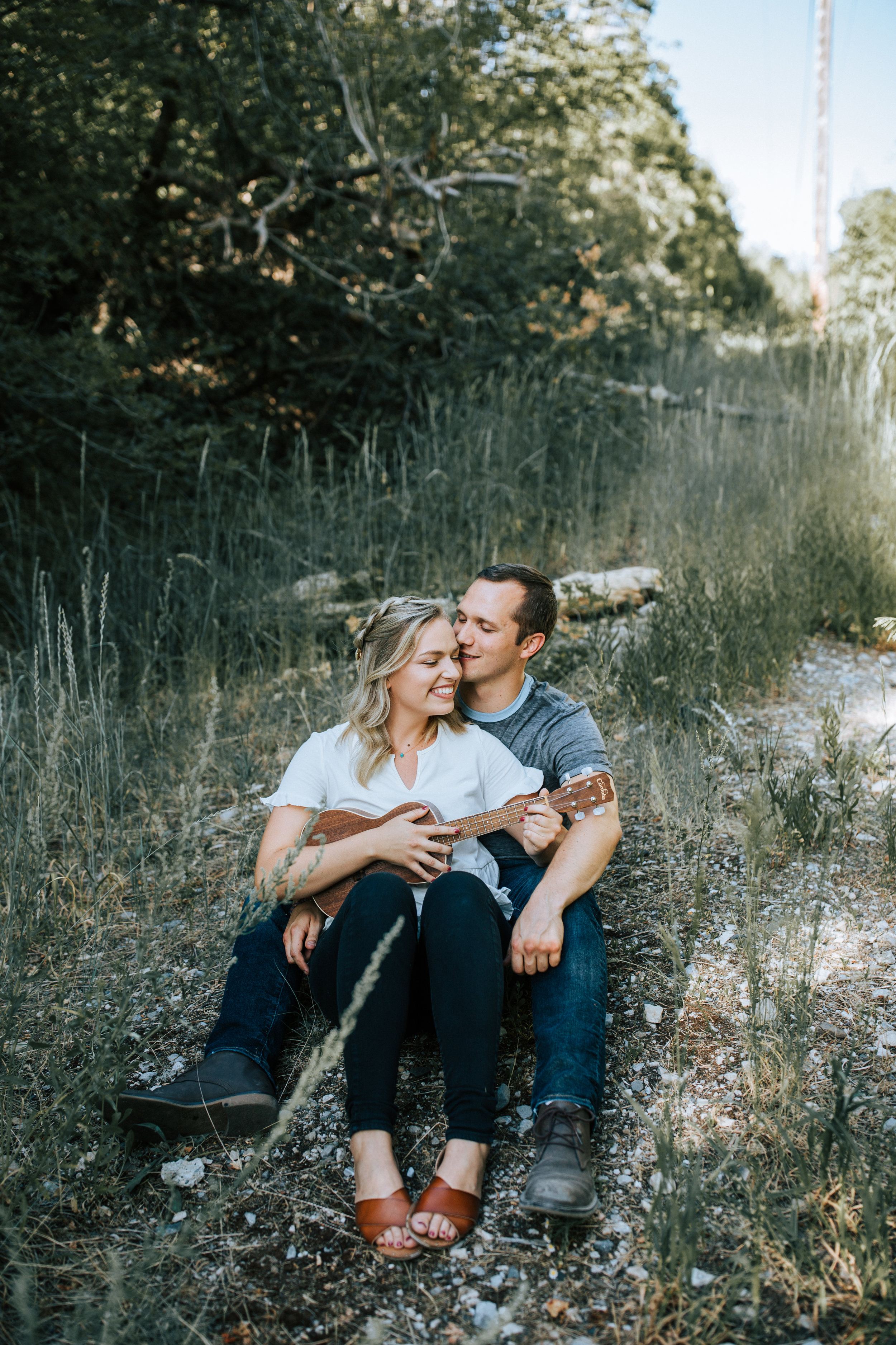 Cozy mountain couple playing ukelele Utah engagement photographer
