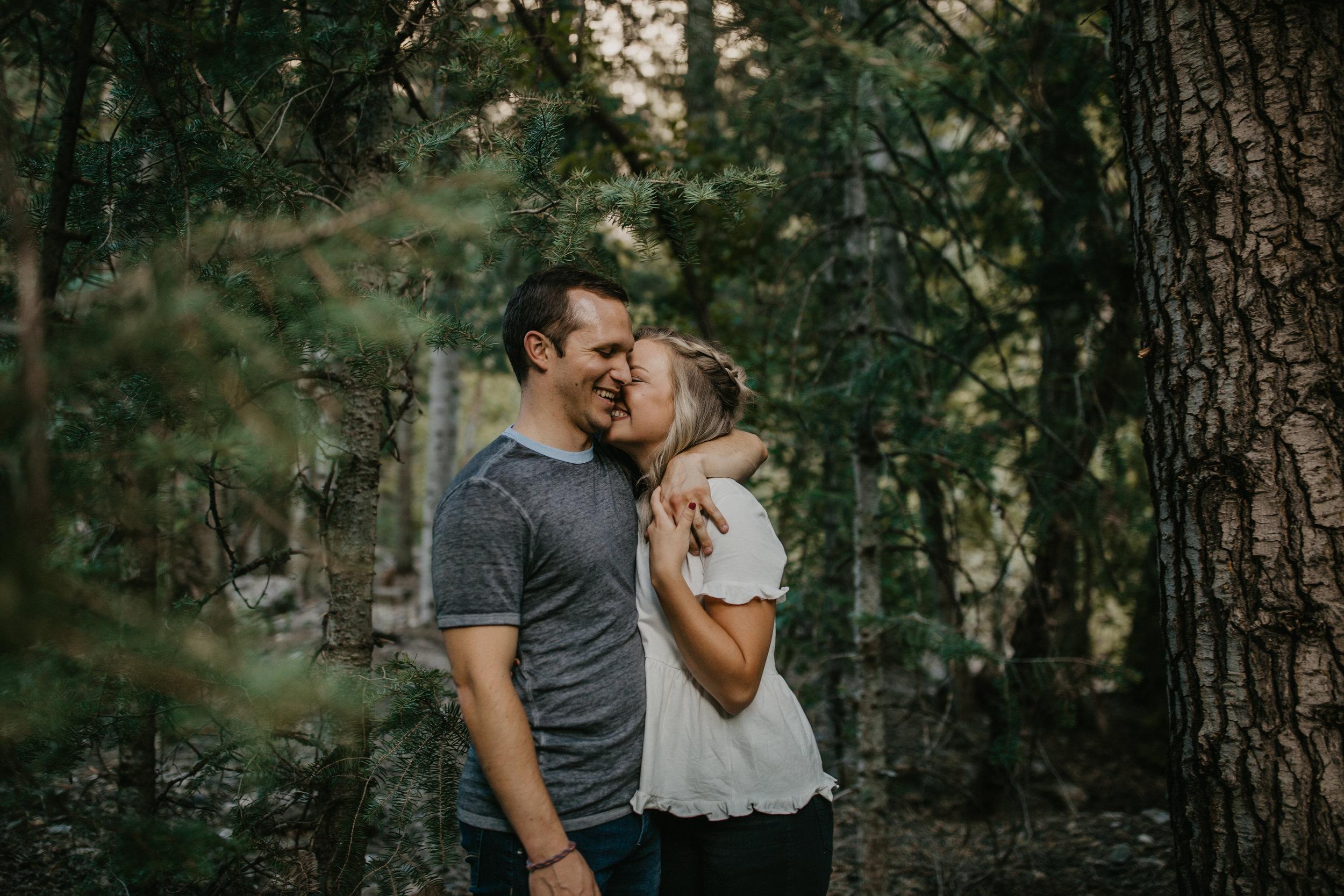 Cozy Utah mountain engagements walking couple
