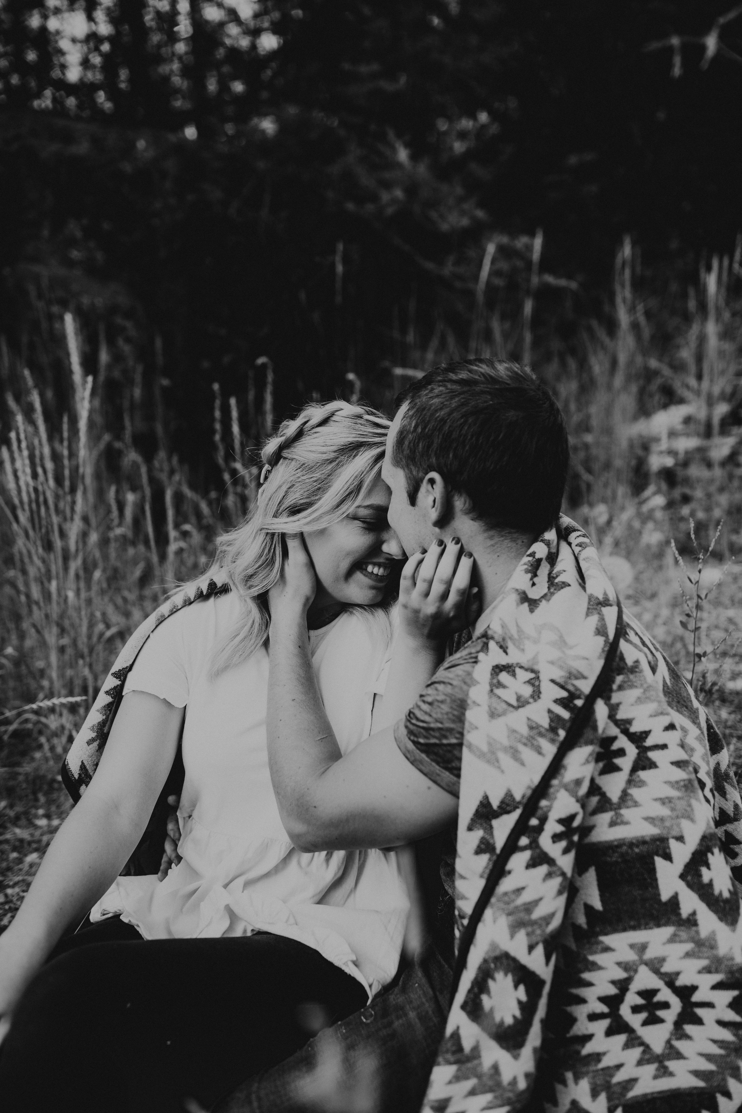 Cozy Utah mountain engagements with blanket