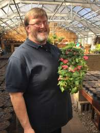 "JOHN - JOHN - a Bears, Cubs and Blackhawk Fan at heart, he grew up in the Chicago area. He started working at JJ's Acres in 1993 and over the years has developed into our ""go to guy"" - John is very knowledgeable in perennials, shrubs, trees, plant care, fungus and disease control."
