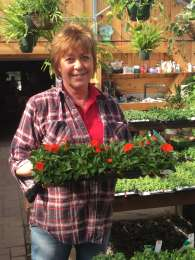 KIM - KIM - grew up in the Lakeland area and truly loves gardening. Kim started at JJ's Acres in the spring of 2007. Her expertise is in annuals & annual care has helped keep the Garden Center unbelievably beautiful...she spends most of her spring planting up custom orders - her container gardening style rocks!