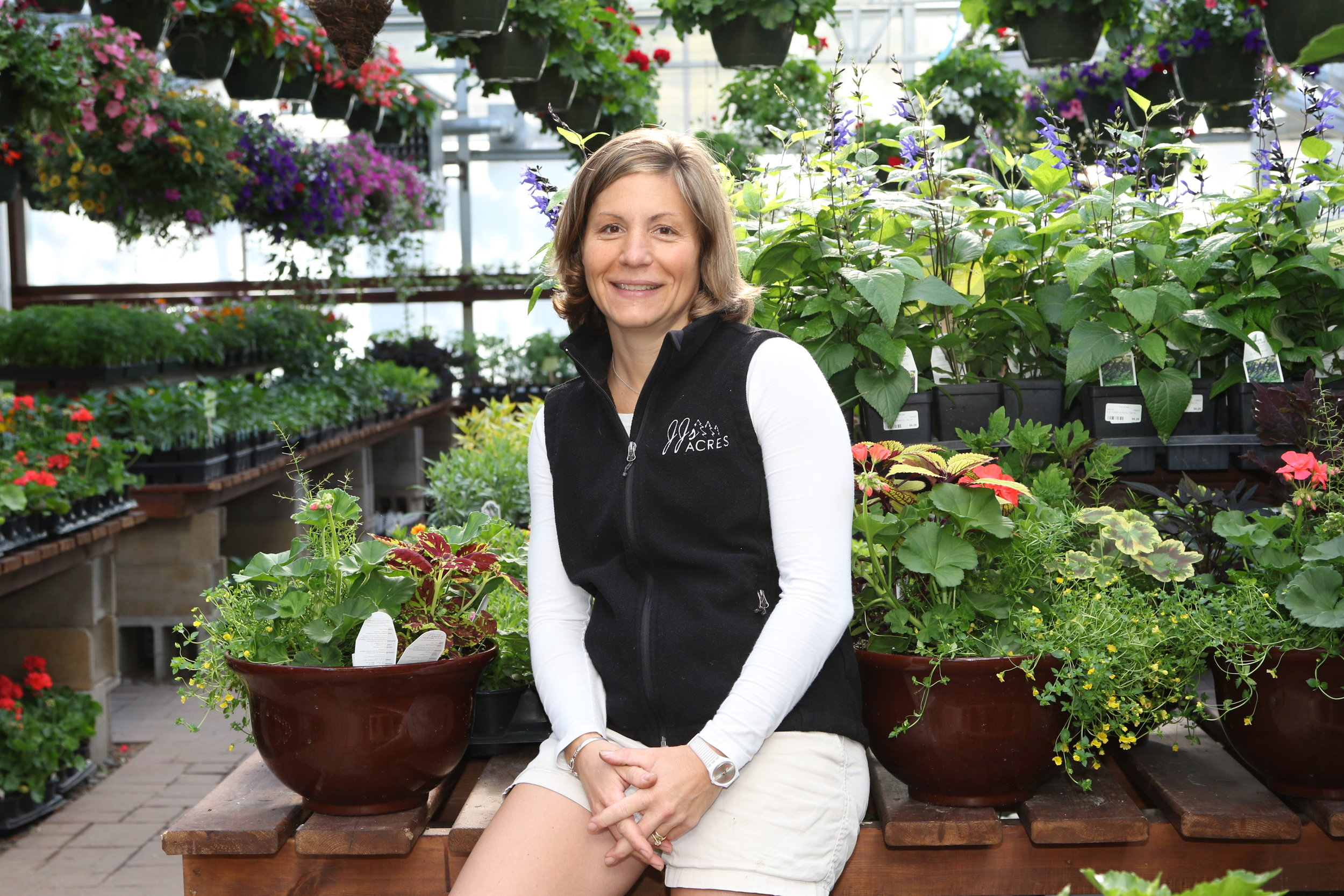 JUDY - JUDY - grew up vacationing in Minocqua. Her family bought plants from JJ's Acres since she was a little girl. When she married Jack she said she'd give the business 3 years to determine whether or not she liked it, she's been here since 1999 and LOVES every day she spends at the Shop!
