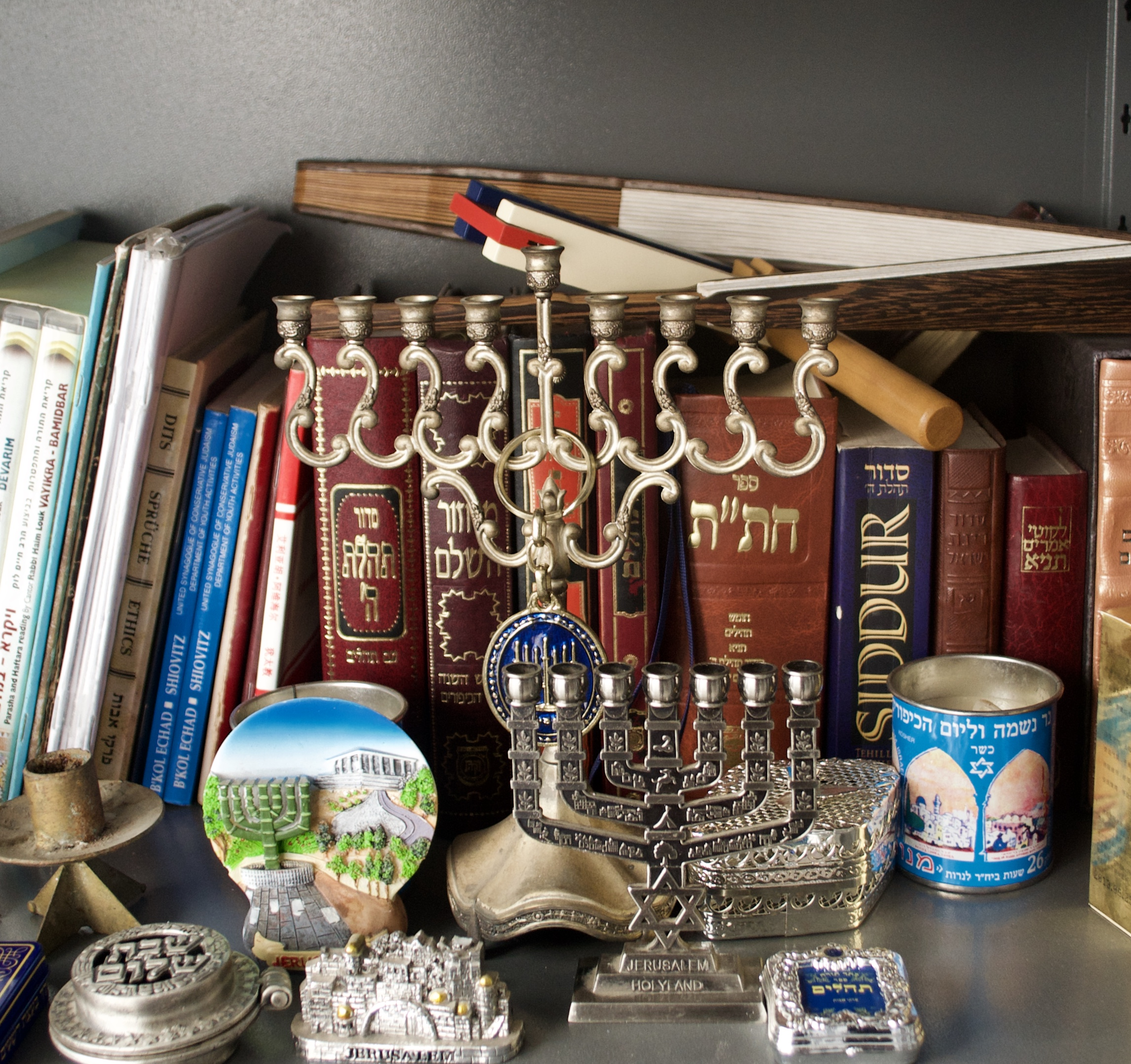 Collection of Menorahs, in a modern Kaifeng Jew household.  [Nicholas Zhang Archives]