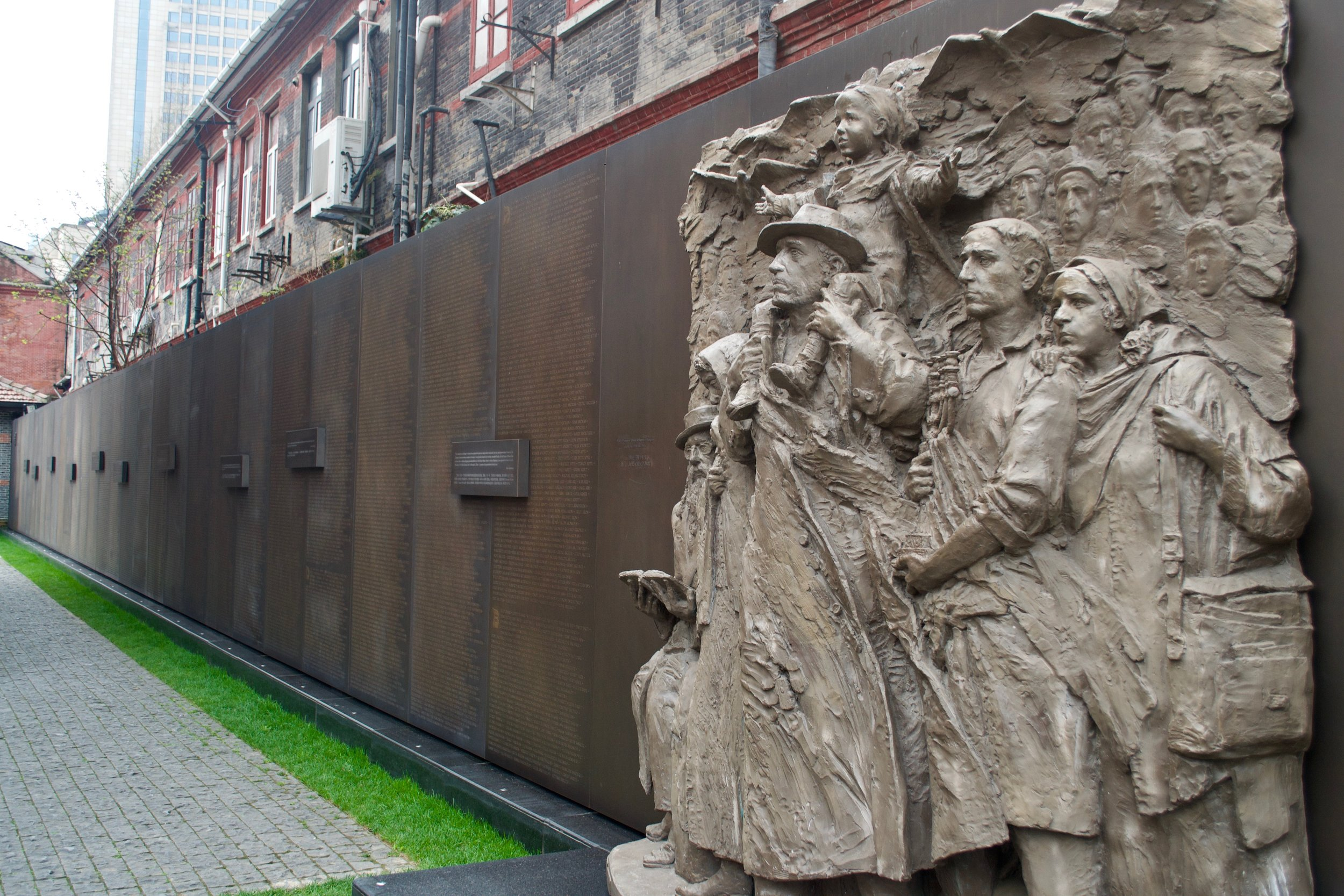 Sculpture wall with 13,732 names of the Jewish refugees who lived in Shanghai. [Nicholas Zhang Archives]