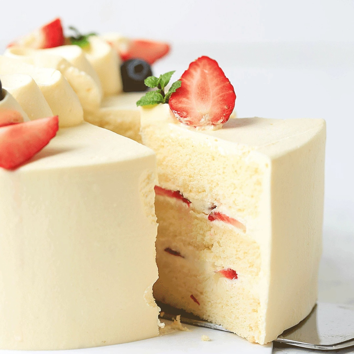 3 Layers with Cream and Strawberries in between