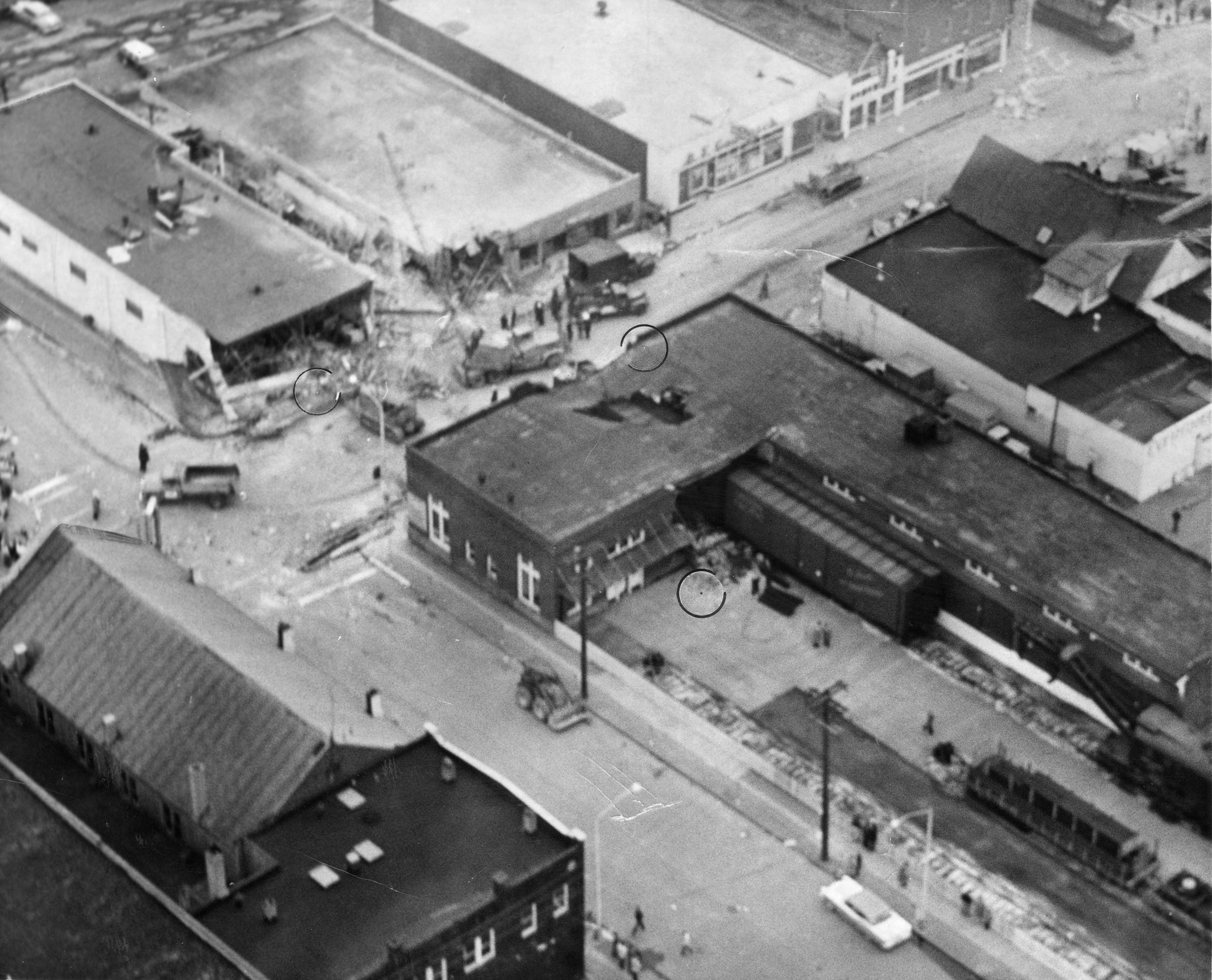 Looking north East from the air on day 2. I believe the building to the right of the train depot is the grocery store that Ruth's family parked in front of after a spot opened up. *State Archives
