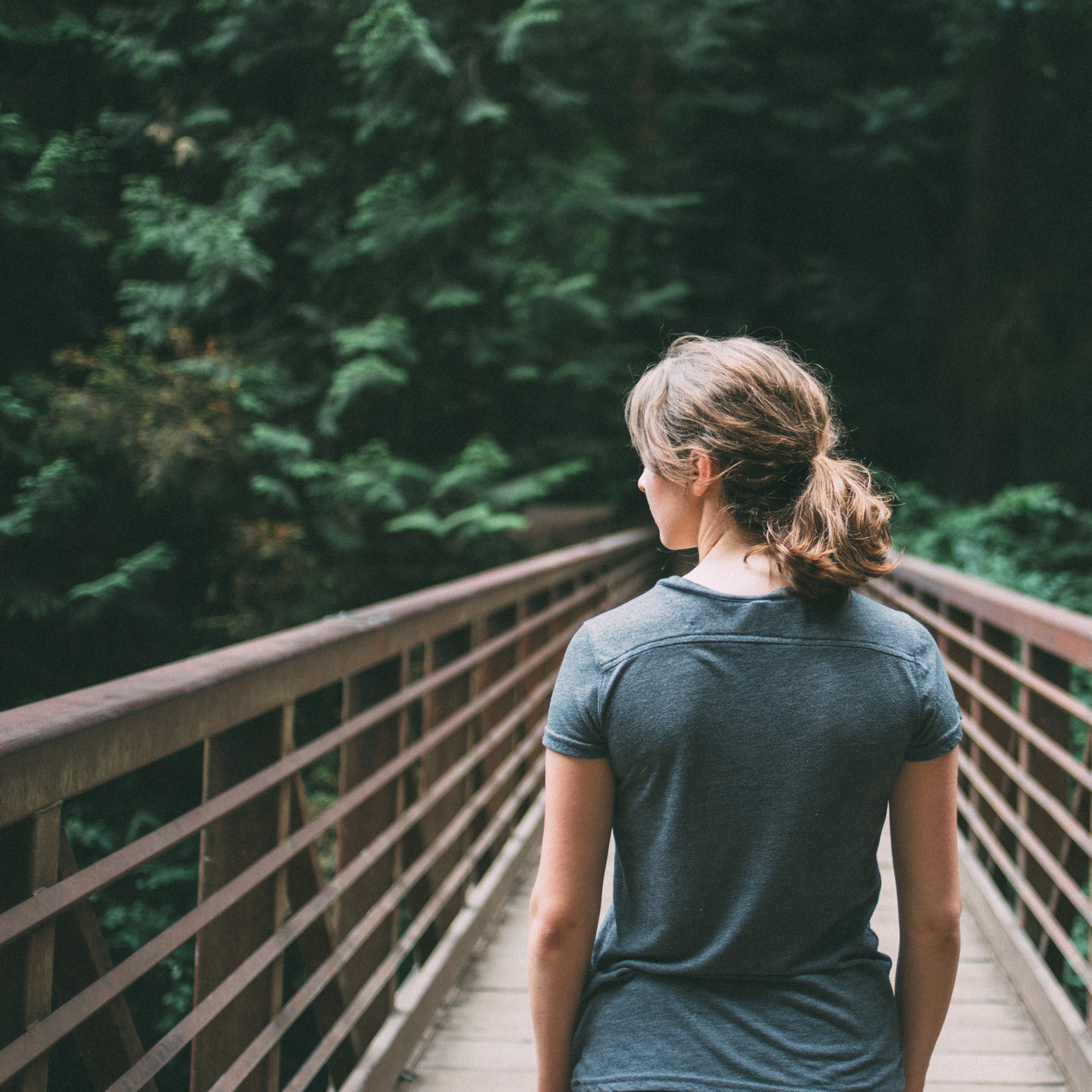 woman-on-bridge-jake-melara-30679-unsplash-crop.jpg