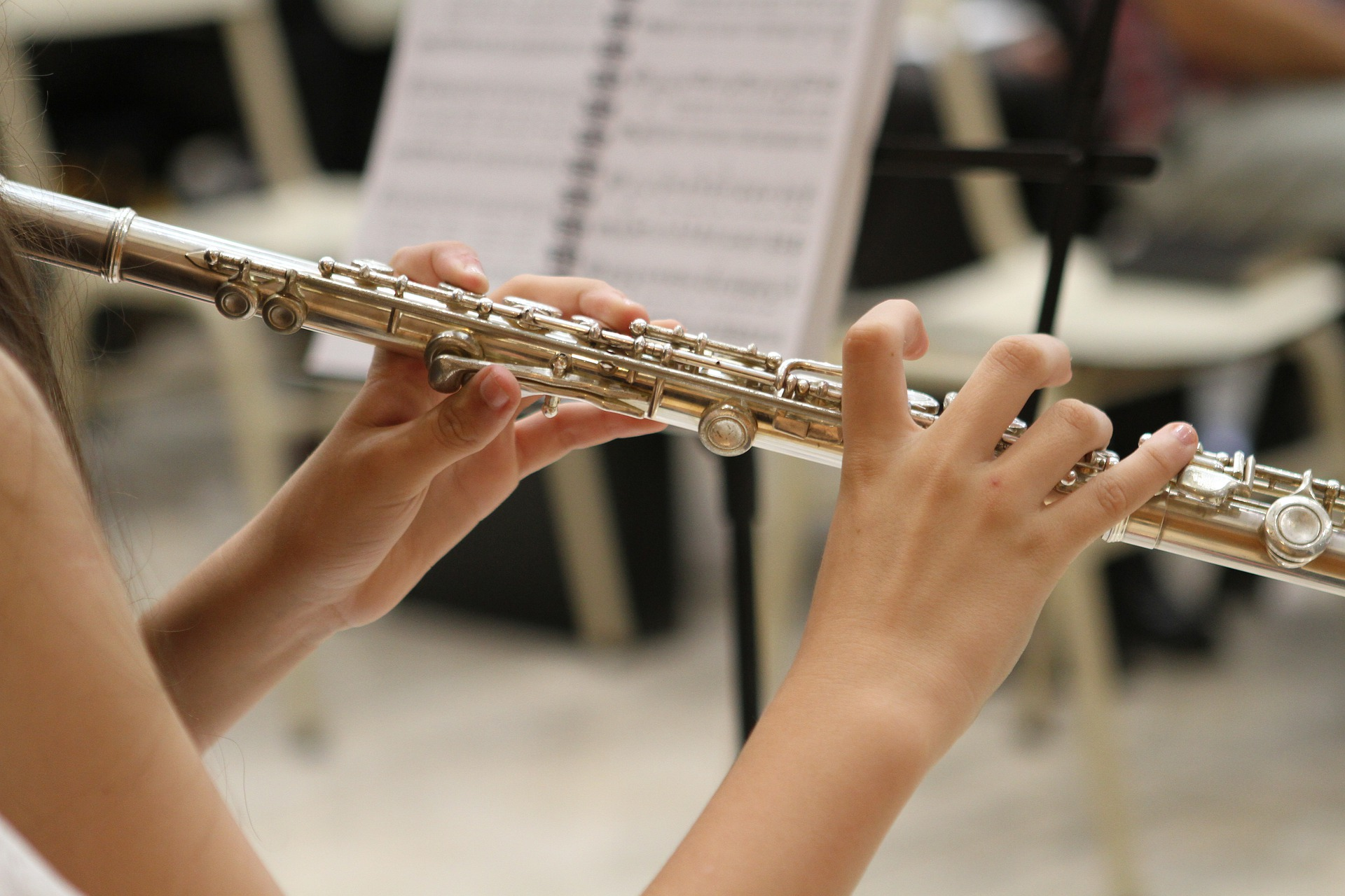 Flautist playing in an orchestra