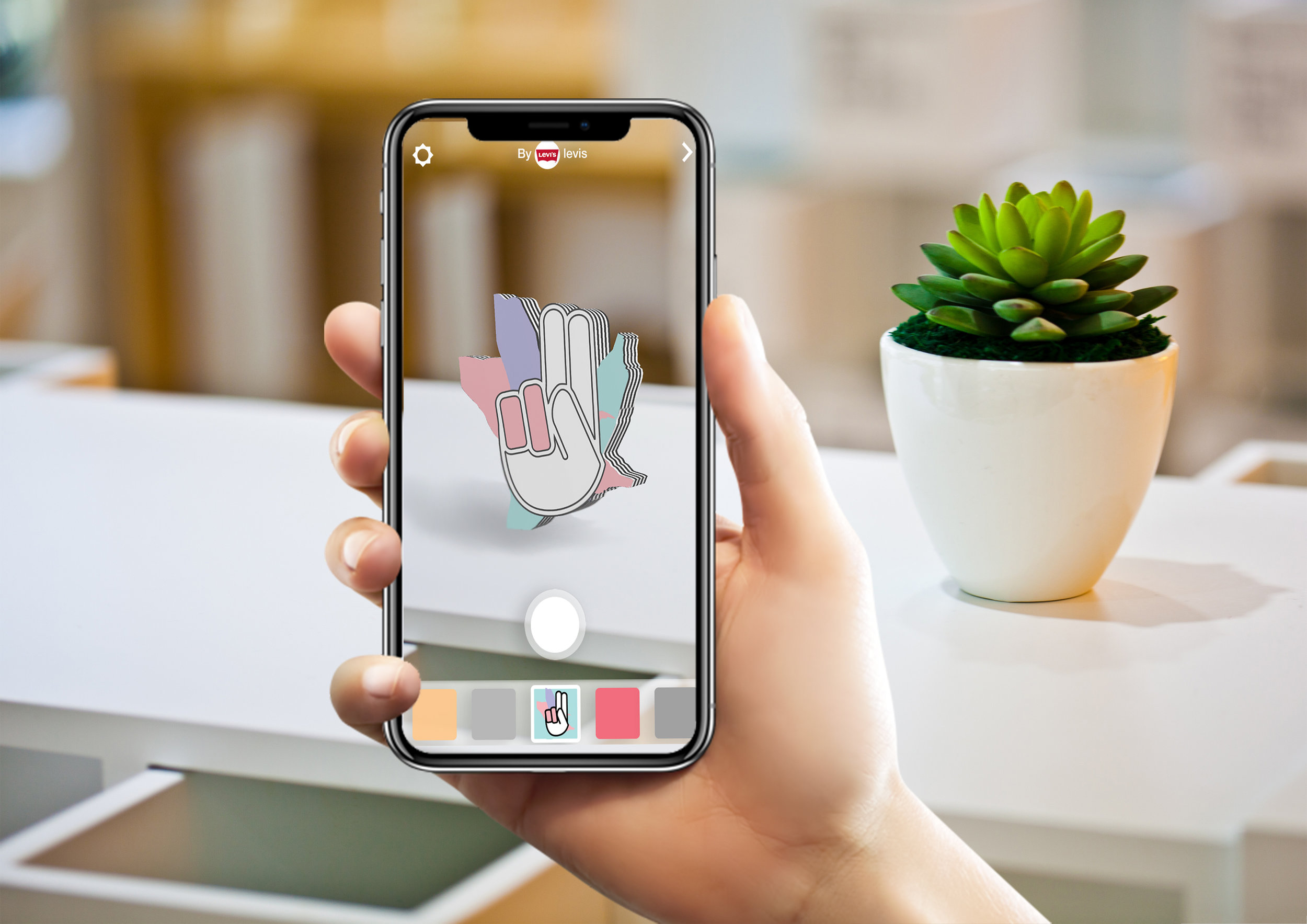 Step #2:Going National - The day after Pride, Levi's premieres a US-wide Instagram AR filter using object recognition. Hovering over everyday items, users can learn and explore the ASL signs in an immersive way.