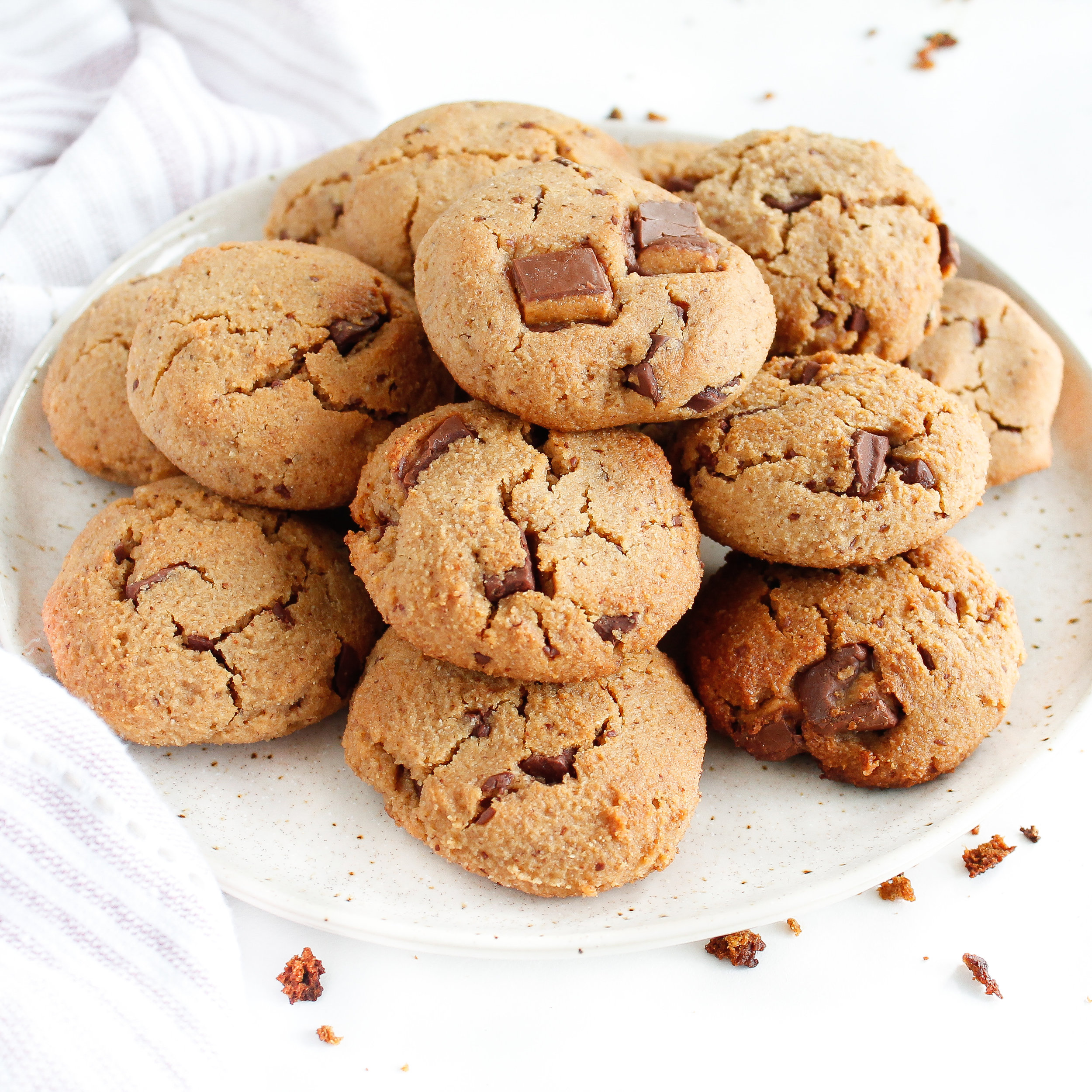Paleo Almond Butter Chocolate Chunk Cookies    These paleo chocolate chunk cookies are grain free, dairy free and refined Sugar Free. They are the perfect healthy sweet treat to curb that sweet tooth and nourish your body! #paleocookies #refinedsugarfree #refinedsugarfreecookies
