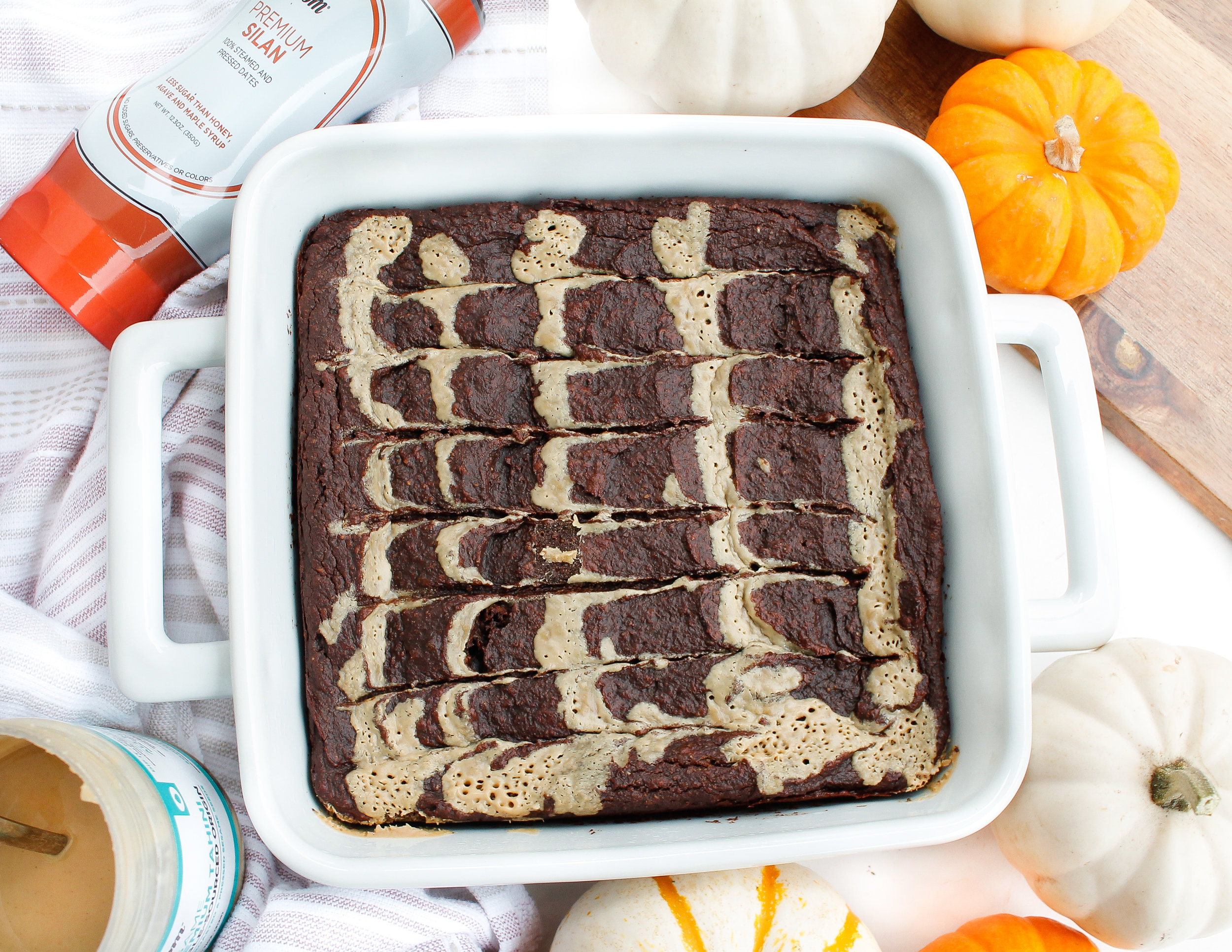 Paleo + Vegan Pumpkin Tahini Brownies || These brownies are grain free, vegan, gluten free AND refined sugar free! They're packed with nutrients from ingredients like pumpkin, raw cacao, tahini and almond flour, so you can have your brownies and eat them too! The perfect healthy dessert when you want to nourish your body and satisfy your sweet tooth. #paleovegan #paleobrownies #paleopumpkinbrownies #veganbrownies #veganpumpkinbrownies #pumpkinbrownies