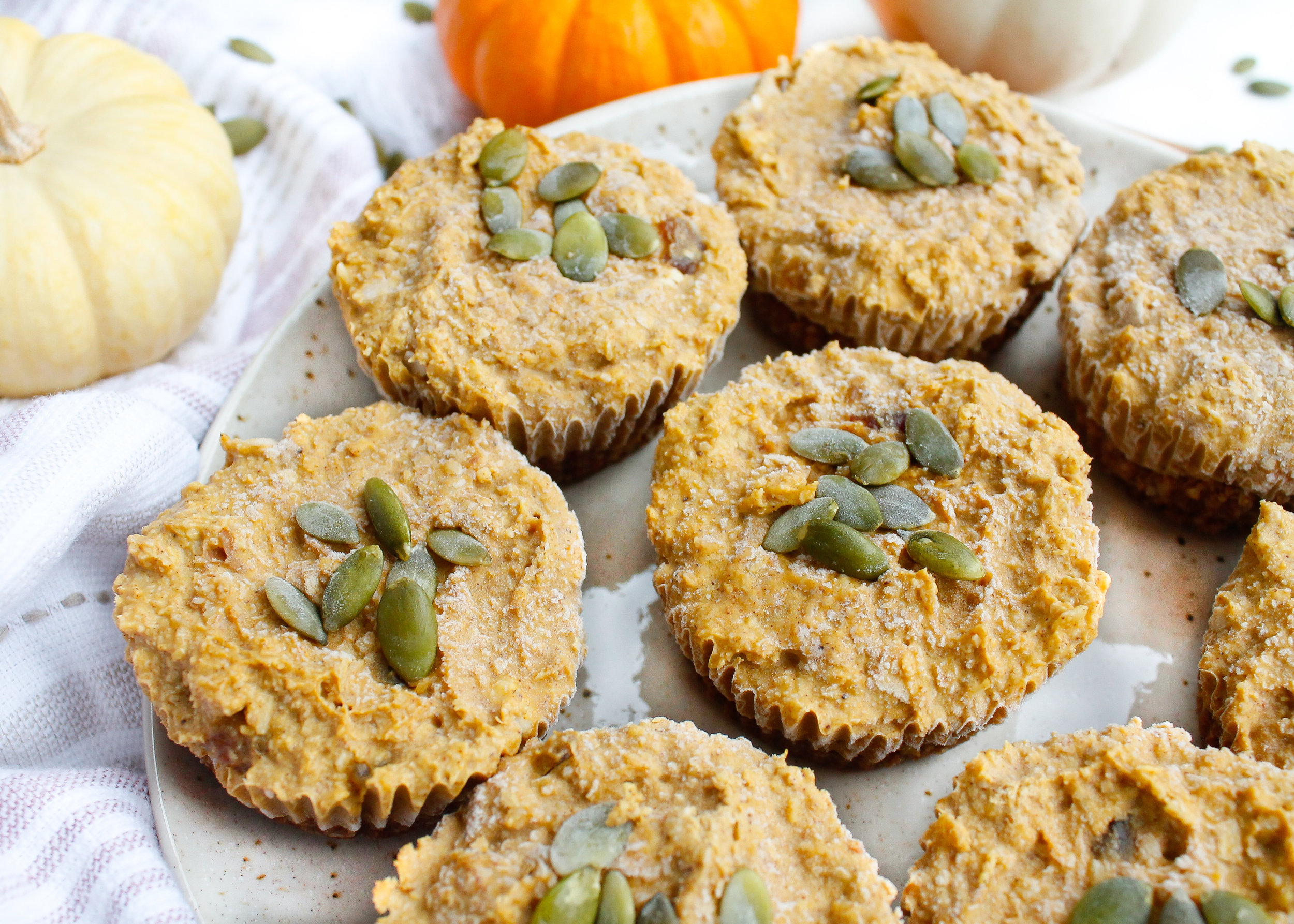 These paleo pumpkin cheesecake bites are the perfect way to say goodbye to pumpkin season! They're also vegan if you sub the honey for maple syrup and they're refined sugar free, grain free, gluten and dairy free and specific carbohydrate diet friendly! They're the perfect healthy, allergy-free holiday dessert. Click through for the recipe! #paleorecipes #dairyfreecheesecake #paleocheesecake