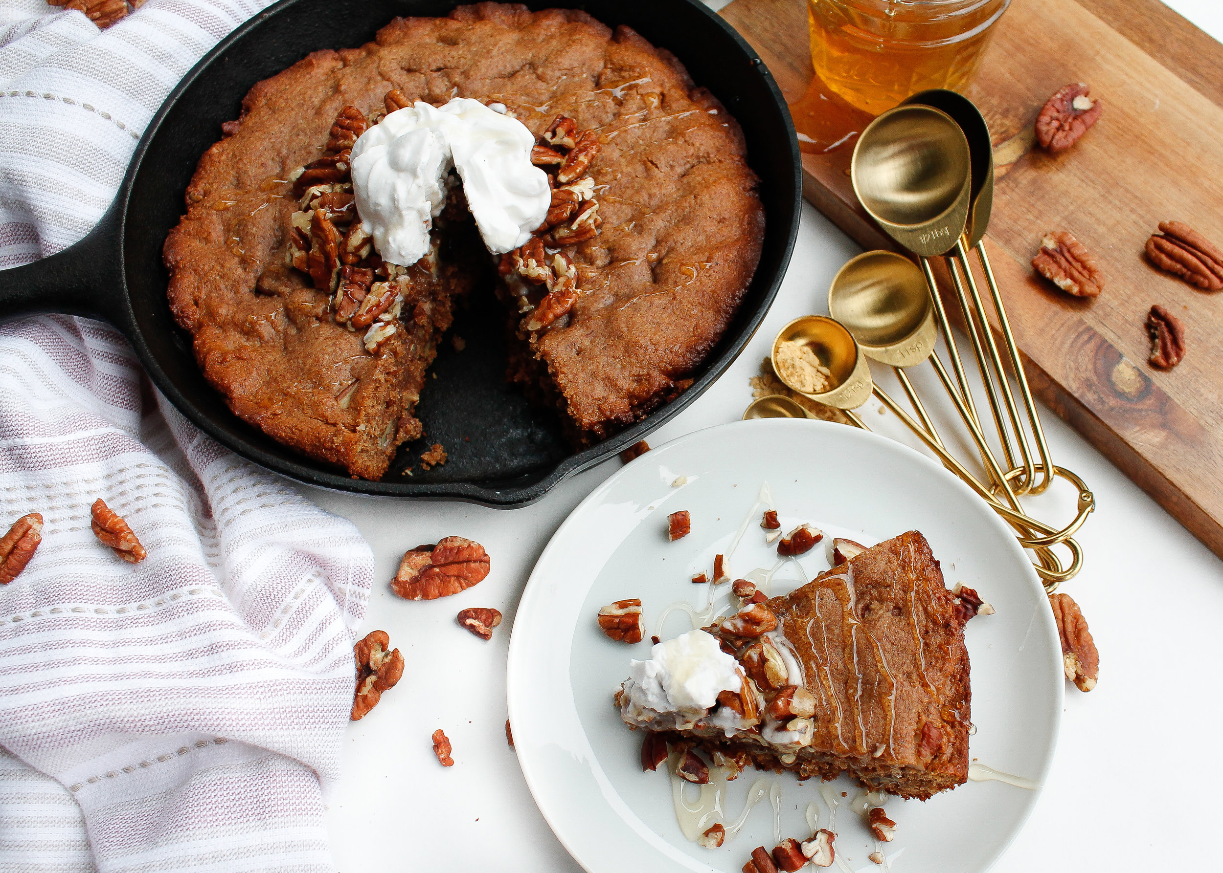 This molasses-free paleo gingerbread skillet is perfect ANY time of the year! It's a great option for healthy dessert or even a healthy, sweet breakfast. Top with candied pecans and coconut yogurt and you're in for a real treat! It's also gluten free, dairy free, refined sugar free and specific carbohydrate diet friendly! #scddiet #specificcarbohydratediet