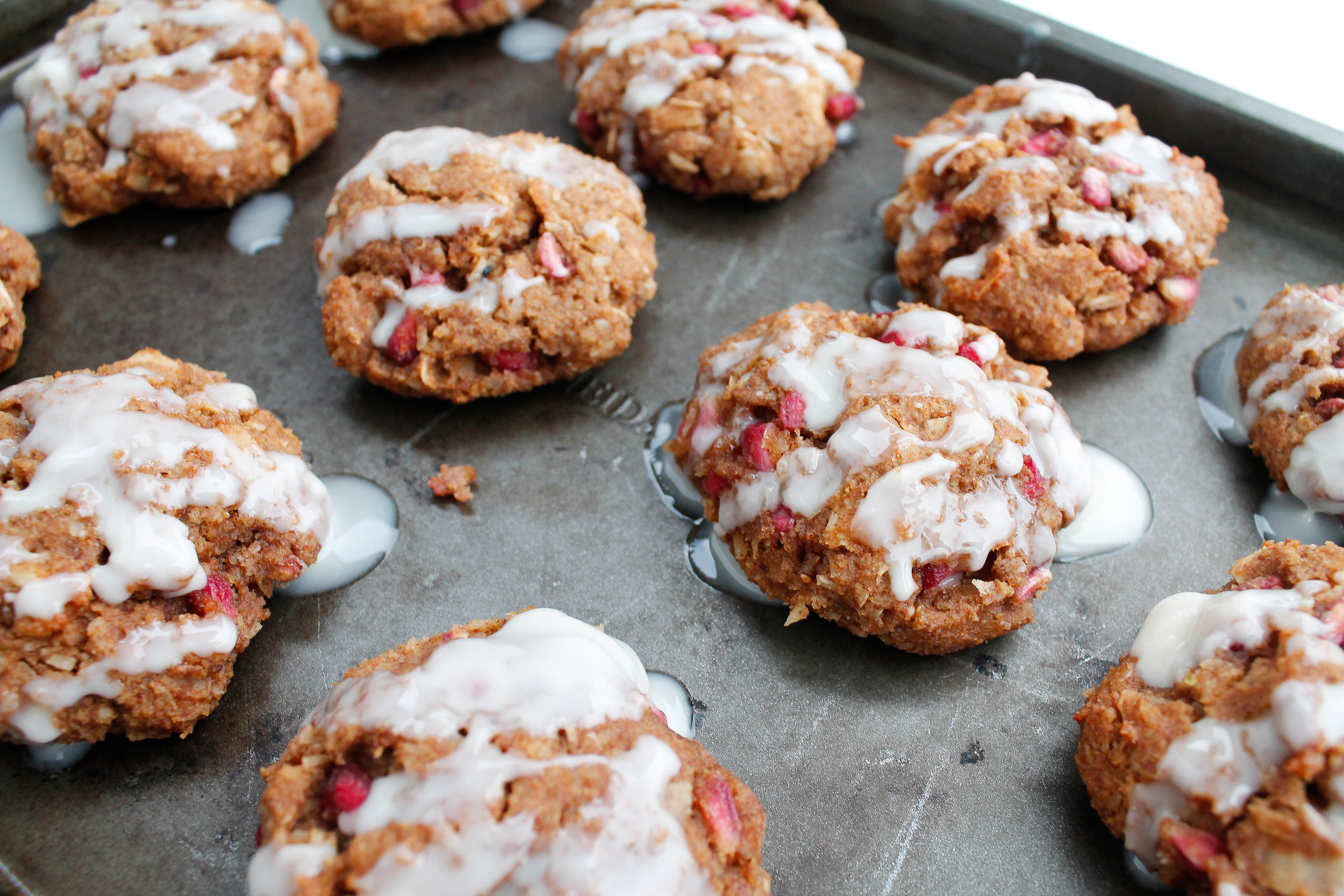 These paleo n'oatmeal cookies are the perfect, grain free, healthy version of classic cinnamon raisin cookies! They're gluten free, dairy free, refined sugar free and Specific Carbohydrate Diet friendly! Made with cinnamon, pomegranate and raw honey, they're the perfect healthy cookie and healthy dessert recipe for a healthy holiday. Click through for the recipe! #paleobaking #specificcarbohydratediet #healthyholidays